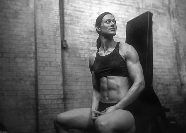 Plant-based athlete Danielle Sidell taking a break during her CrossFit workout.