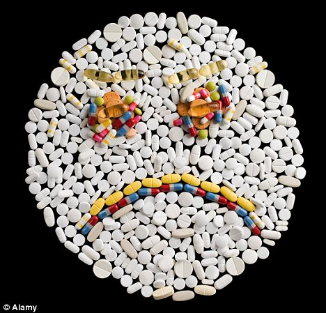 A frowny face made up of pills.