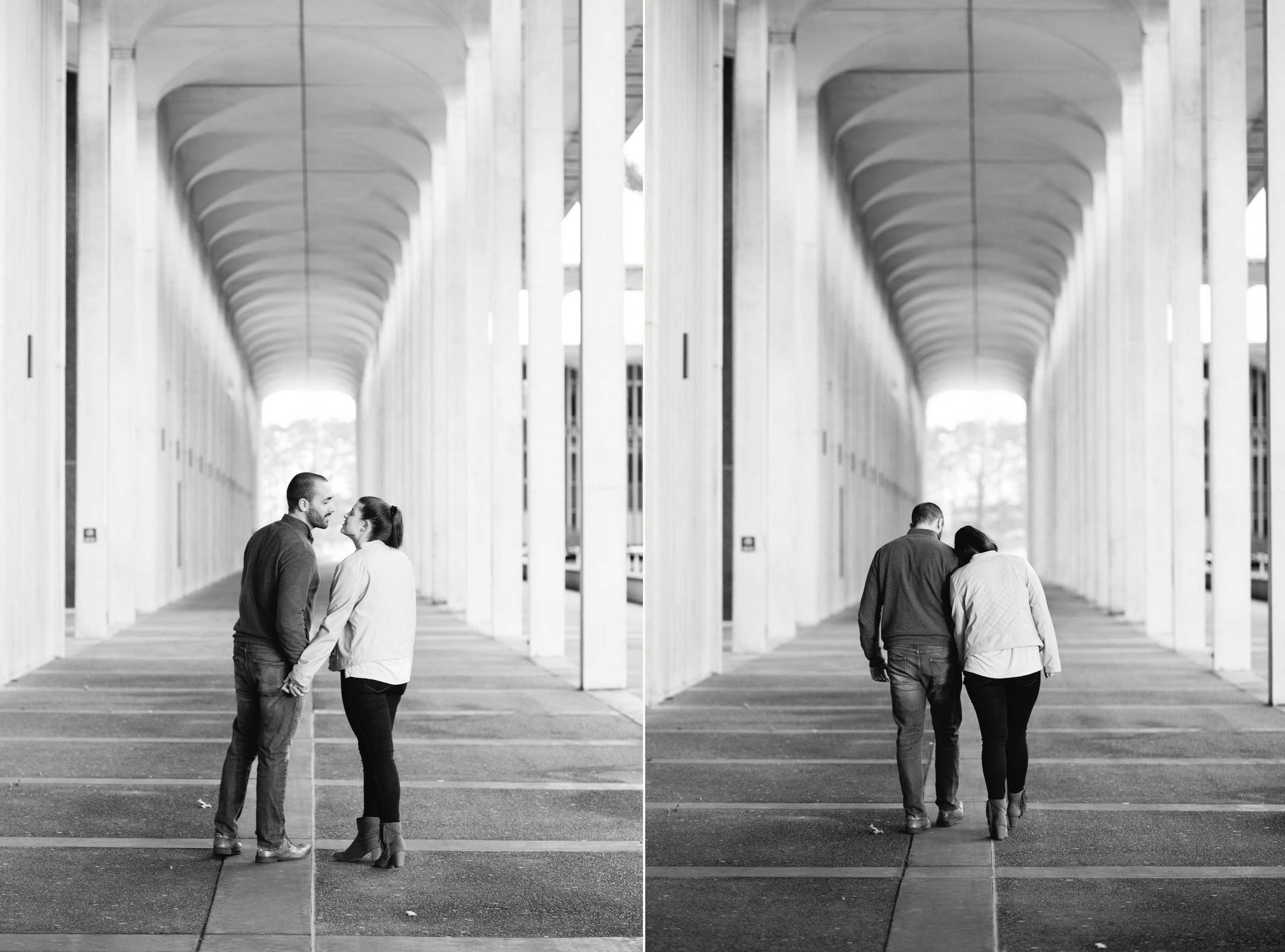 A young caucasian man and woman lean in to kiss under some arches on the University of Albany campus.
