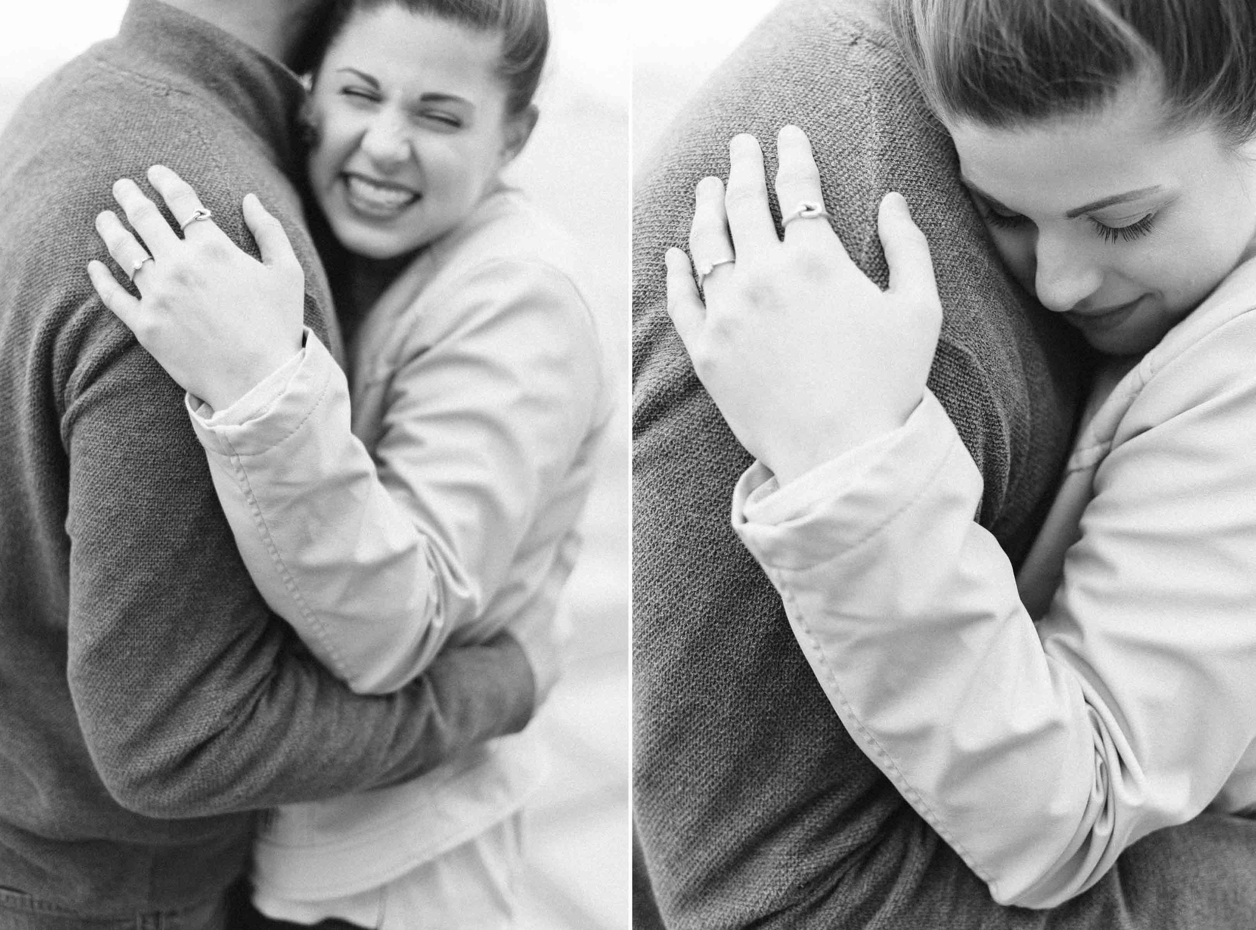 A closeup black and white image of a young Caucasian man and woman as they embrace joyfully.