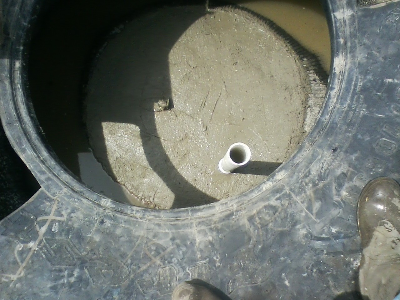 concrete poured in bottom of tire waterer.jpg