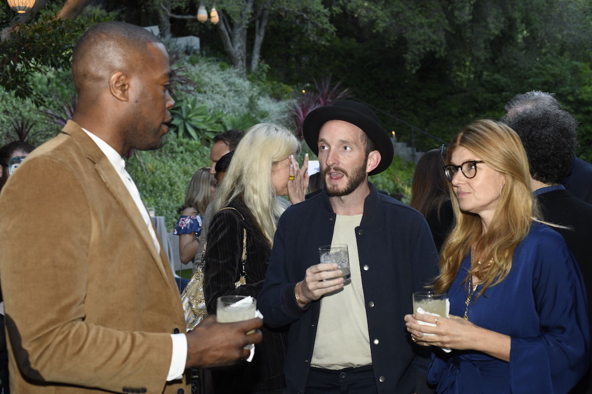Advisory Board Member Connie Britton talks with Aaron Rouse and Jedidiah Jenkins.