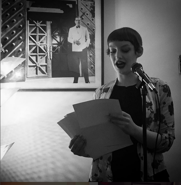 """""""The fun stops here, 'cause this is all about death."""" Reading at Knife Fork Books for Words(on)Stages (photo by A. Zachary)"""