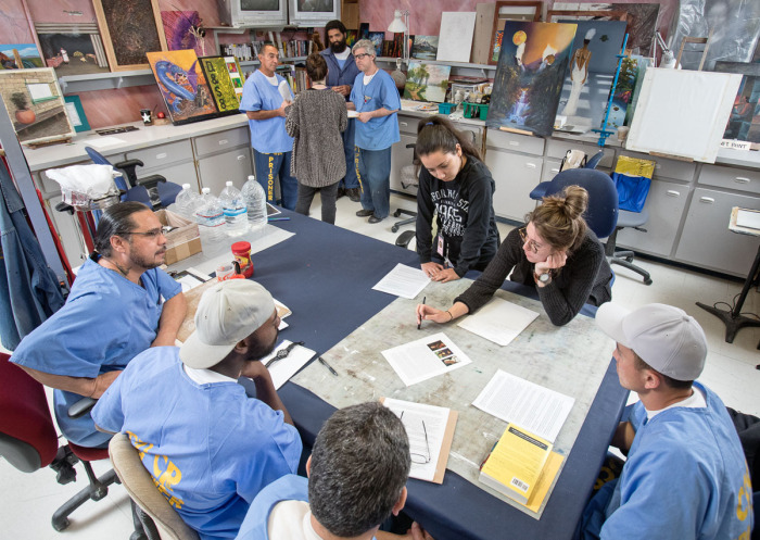 Members of CSUSB Prison Arts Collective in a visual arts class at the California State Prison, Los Angeles County. Photo by Peter Merts.