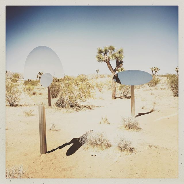 """Thanks to everyone who was able to make it out today to see Sarah Vanderlip's new Site-specific Installation """"Untitled (Double Ellipses) 2018. Feel free to stop by if you are in the Joshua Tree area...the installation will be up for an extended period of time. See Sarah's CA Truckheads, 2004 a permanent installation @highdeserttestsites """"Behind the Bail Bonds"""" about 2miles from the Rough Play Projects site. Directions available on the HDTS site. #sarahvanderlip @sugarjarvacancy #sitespecificinstallation #roughplayprojects #joshuatree #doubleellipses"""
