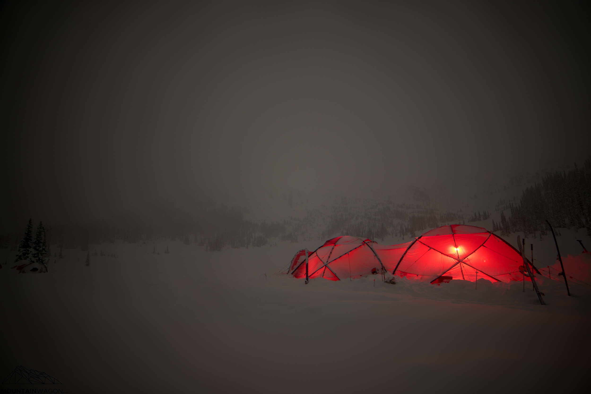 Nighttime glow from our cozy domes.