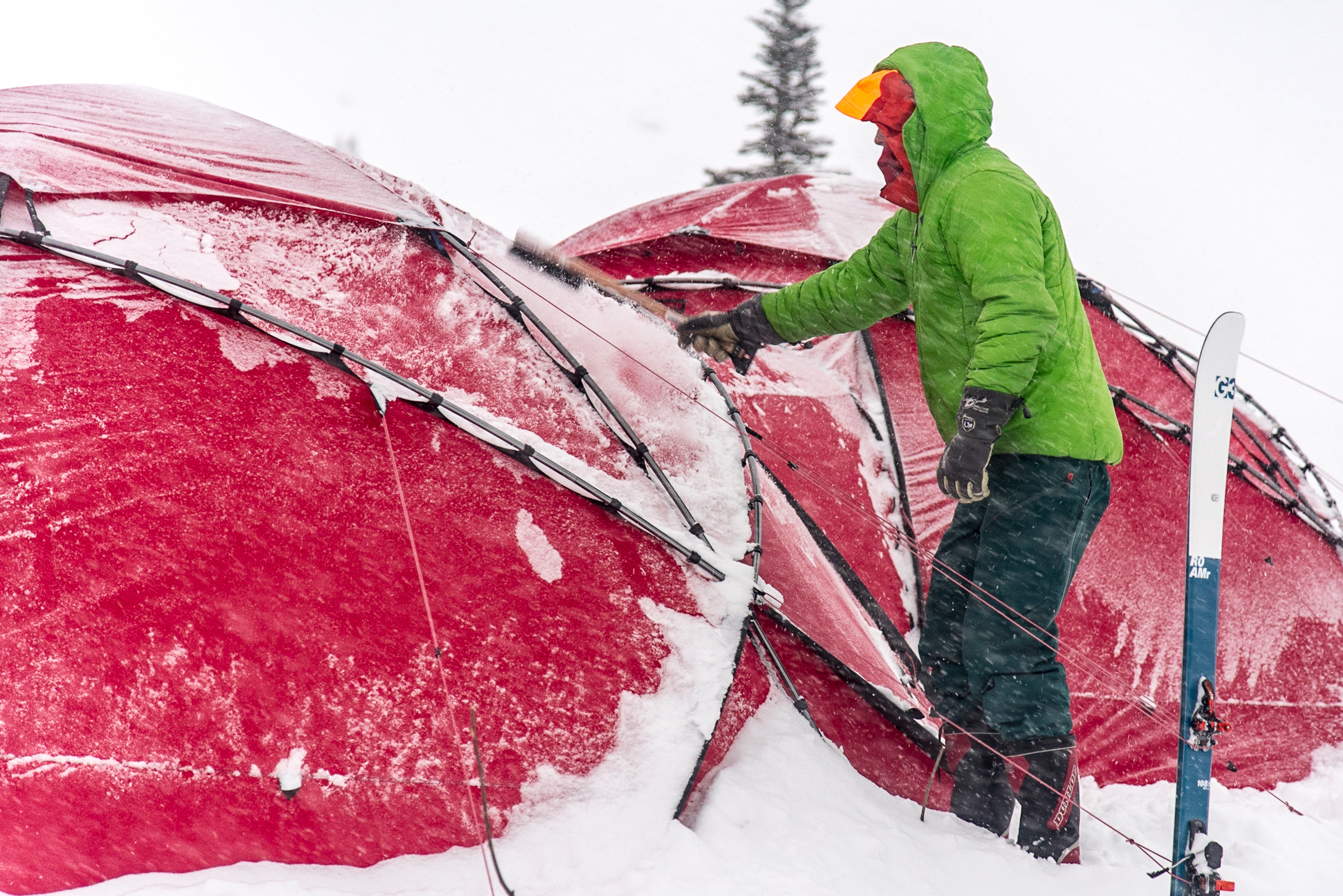 Keeping the tents snow free in a big storm. Photo Phil Tomlinson.