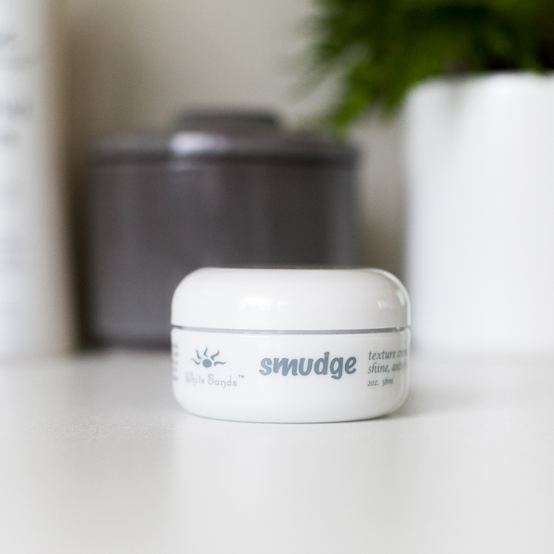 Smudge Texture Creme - Smudge is a water-based, weightless styling and finishing product perfect on wet or dry hair. It always leaves hair soft, silky, and touchable. Smudge can be used for piecing, straightening, texturizing, anti-frizz, and flat ironing. When Smudge dries, it is weightless and infuses silkiness.60ml