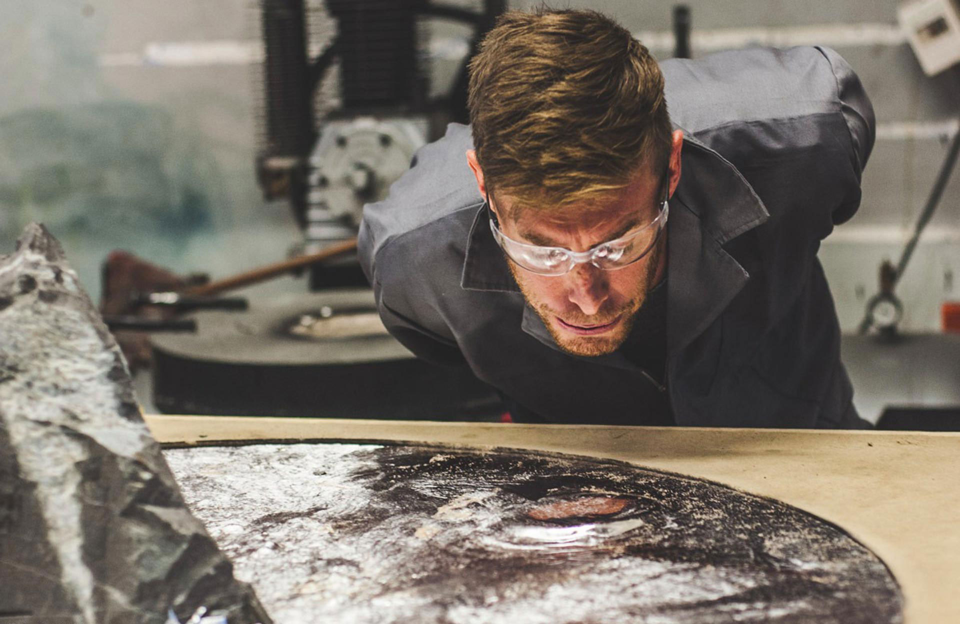Jesse taking a closer look at one of his creations —  Lunar Table. (Photo by Devin Paisley)