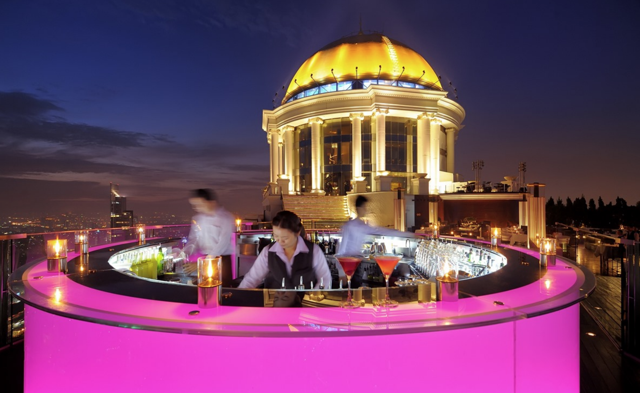 SKY BAR AT LEBUA   Not only has it been voted one of the  best rooftop bars in the world  but it has also been voted one of the highest and most stylish rooftop bars you will ever see. You might recognise it from  this scene  in  The Hangover II movie and now you too can sip the well-known  Hangovertini,  which their mixologists created for the famous cast during filming. The drama of the multi-hued florescent bar against the backdrop of the dome and the best views in Bangkok makes this a must-see highlight.   Map | Website | Instagram