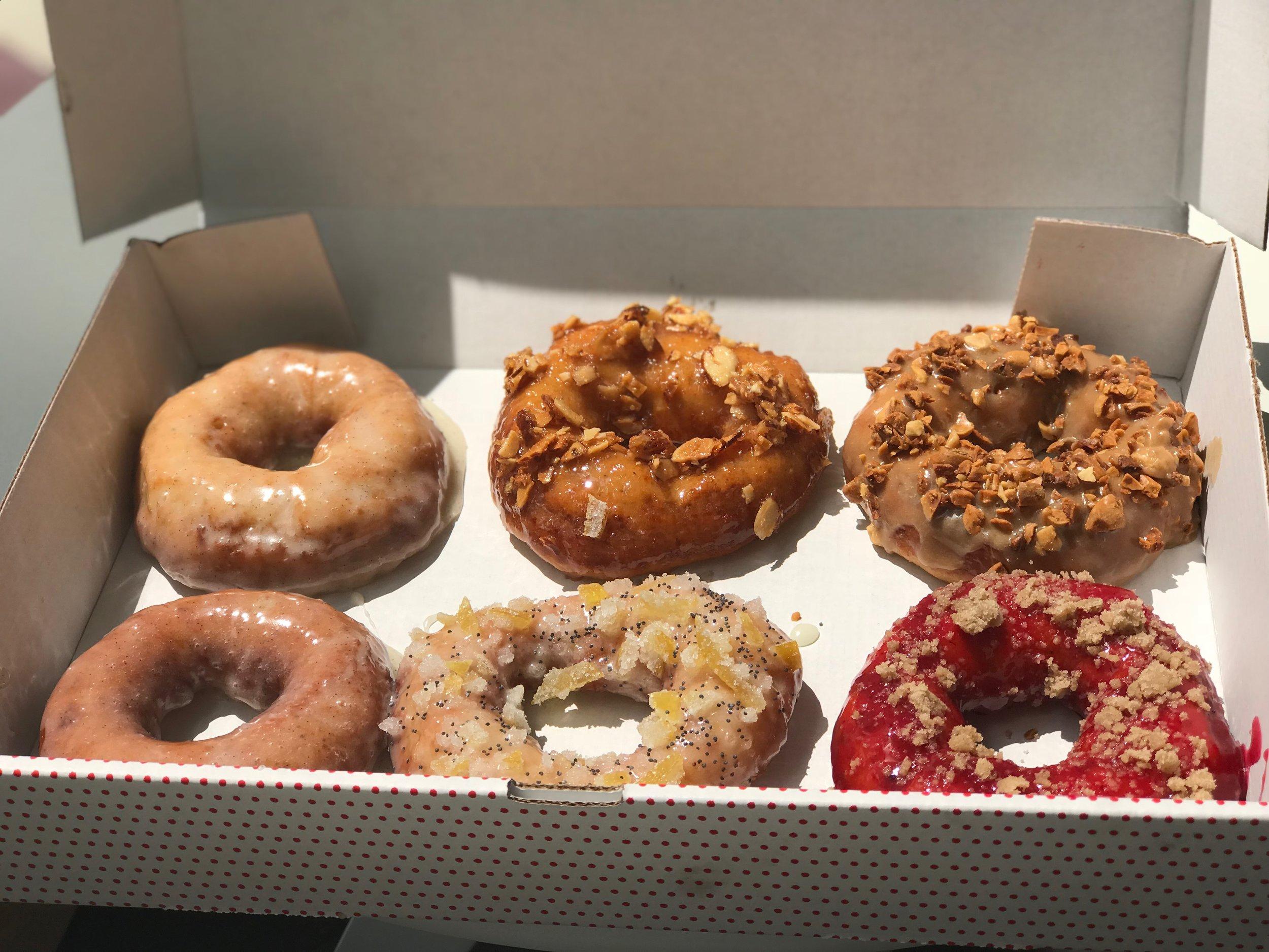 From top left: Vanilla Glaze, Nectarine Glaze, Maple Bourbon, Vanilla Glaze (repeat), Lemon Poppy, and Blackberry Cobbler