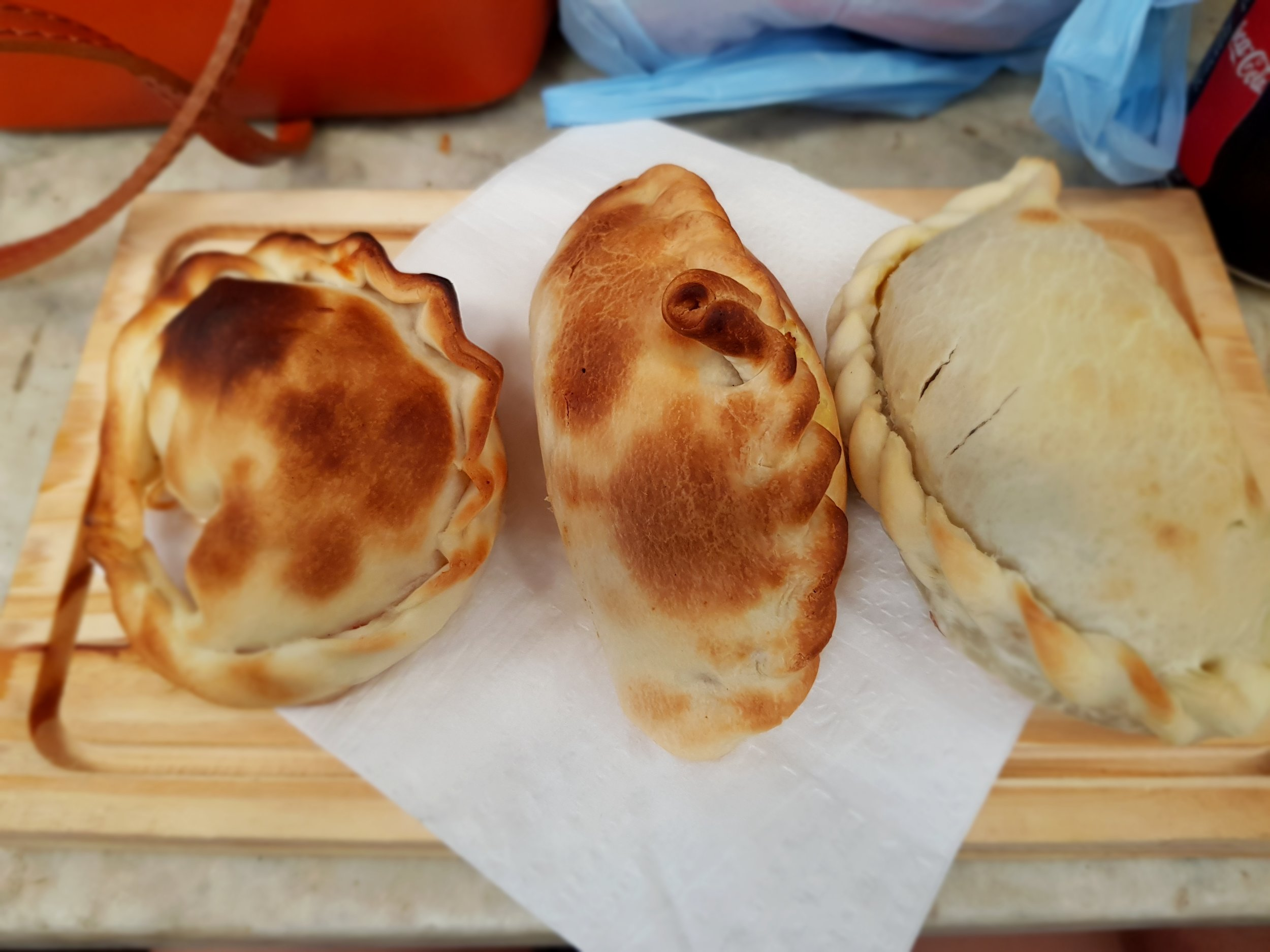 A trio of authentic empanadas from the San Telmo food market in Buenos Aires, a must-visit for any foodies!
