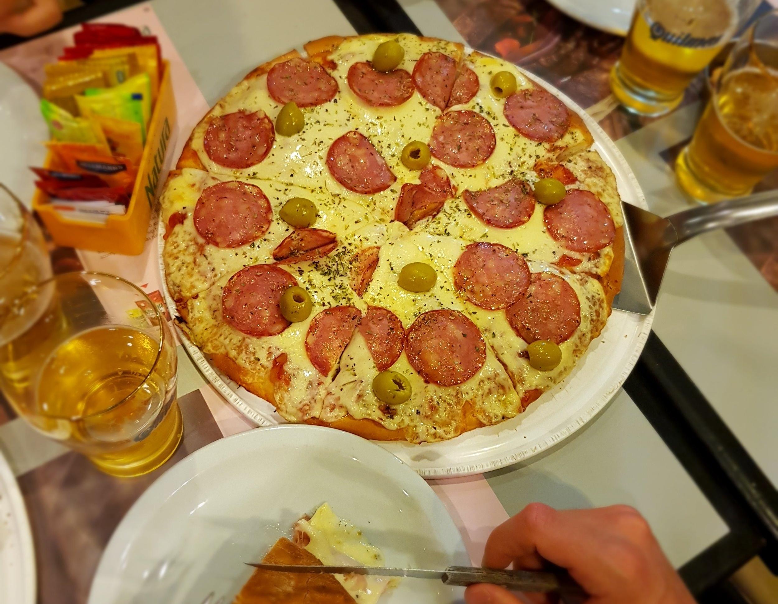 A salami pizza from the popular pizza place La Martianita in Mar del Plata.