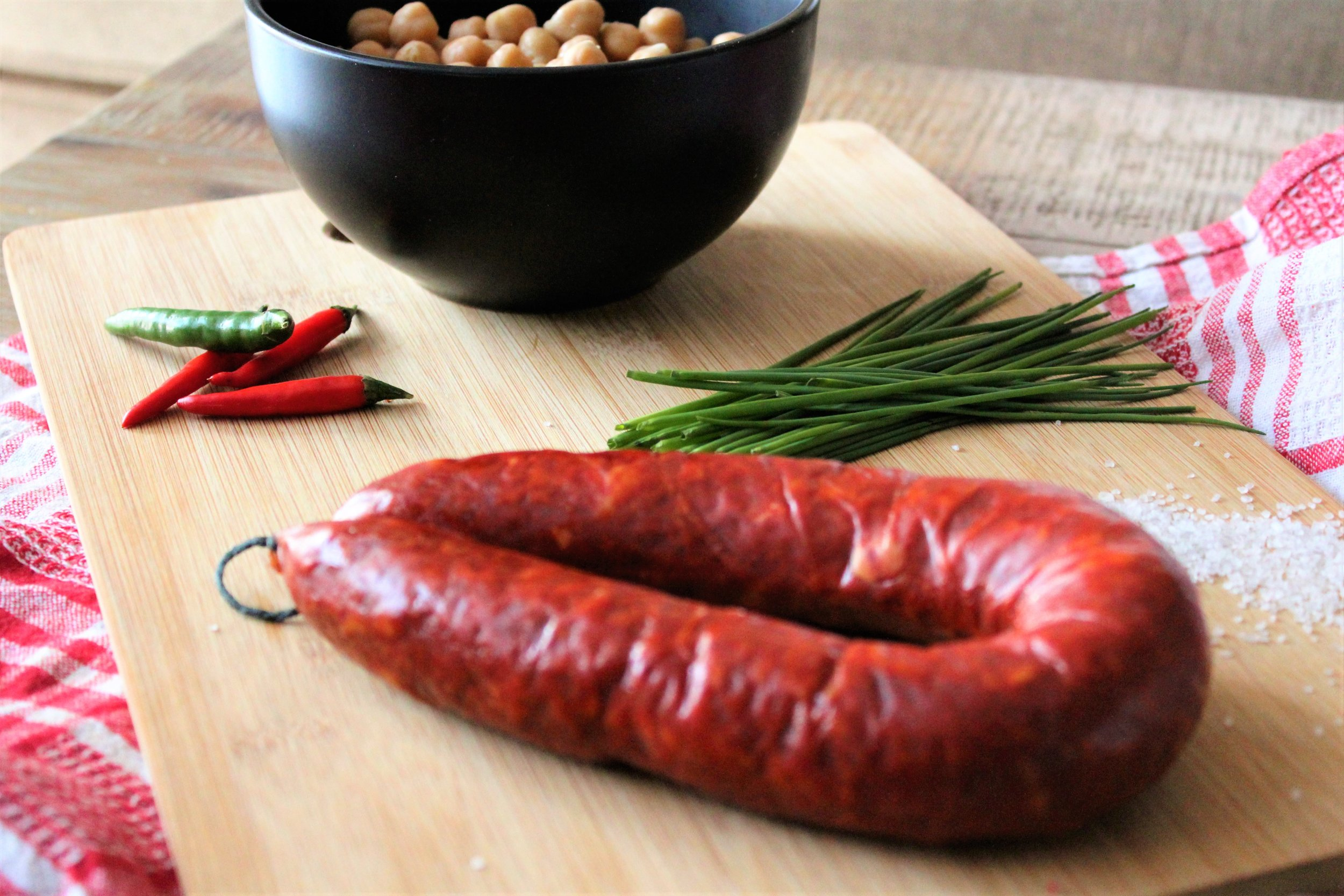 All you need - 2 Tbsp olive oil 1 fresh chili 1 Spanish chorizo (250gm)- sliced diagonally into half cm slices1 tsp minced garlic Half chopped onionTin of Chickpeas - washed & drainedHalf cup chicken stock Handful chopped chives Half tsp salt
