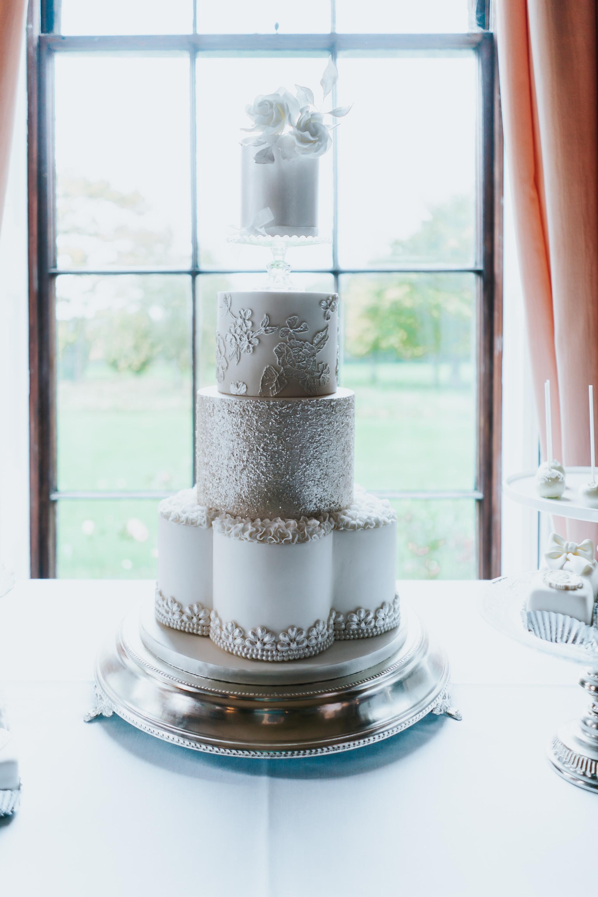Classic white petal tier wedding cake
