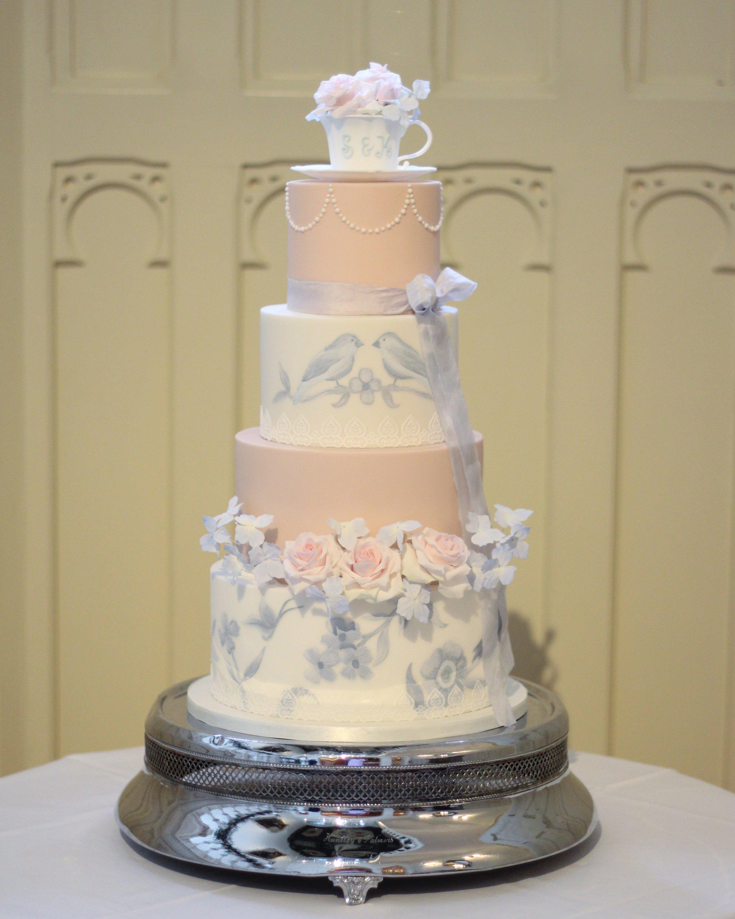 Blue & blush hand painted wedding cake