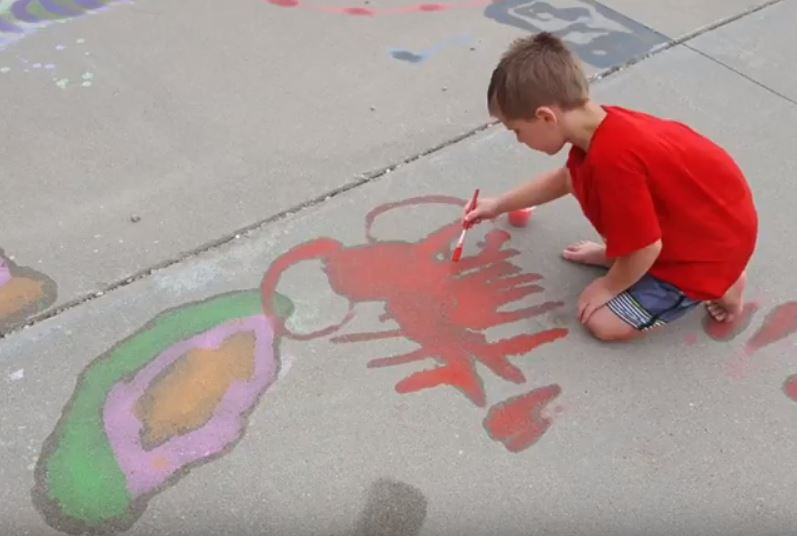 Summer Photo 1 boy painting sidewalk.JPG