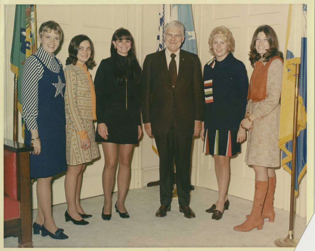 """PROTECTION: THE FIRST FIVE WOMEN (feature film & television series) - BY: Clark ChildersForty years ago there was a milestone event in United States Secret Service history.It was the first time in the organization's 106 year founding that a woman, five women to be precise, would be sworn in as special agents.The Washington Post published an article for the unprecedented occasion.Dateline: WASHINGTON (UPI) – Five young women took the oath of office today as special agents of the U.S. Secret Service, and became the first of their sex to join the 106-year–old agency. Customarily, they would be referred to as """"pretty"""" or at least """"attractive,"""" since this is true of most young women successful in their careers.The story follows Kathryn Childers through her time working at the White House to meeting The Kennedys and protecting their daughter, Caroline."""