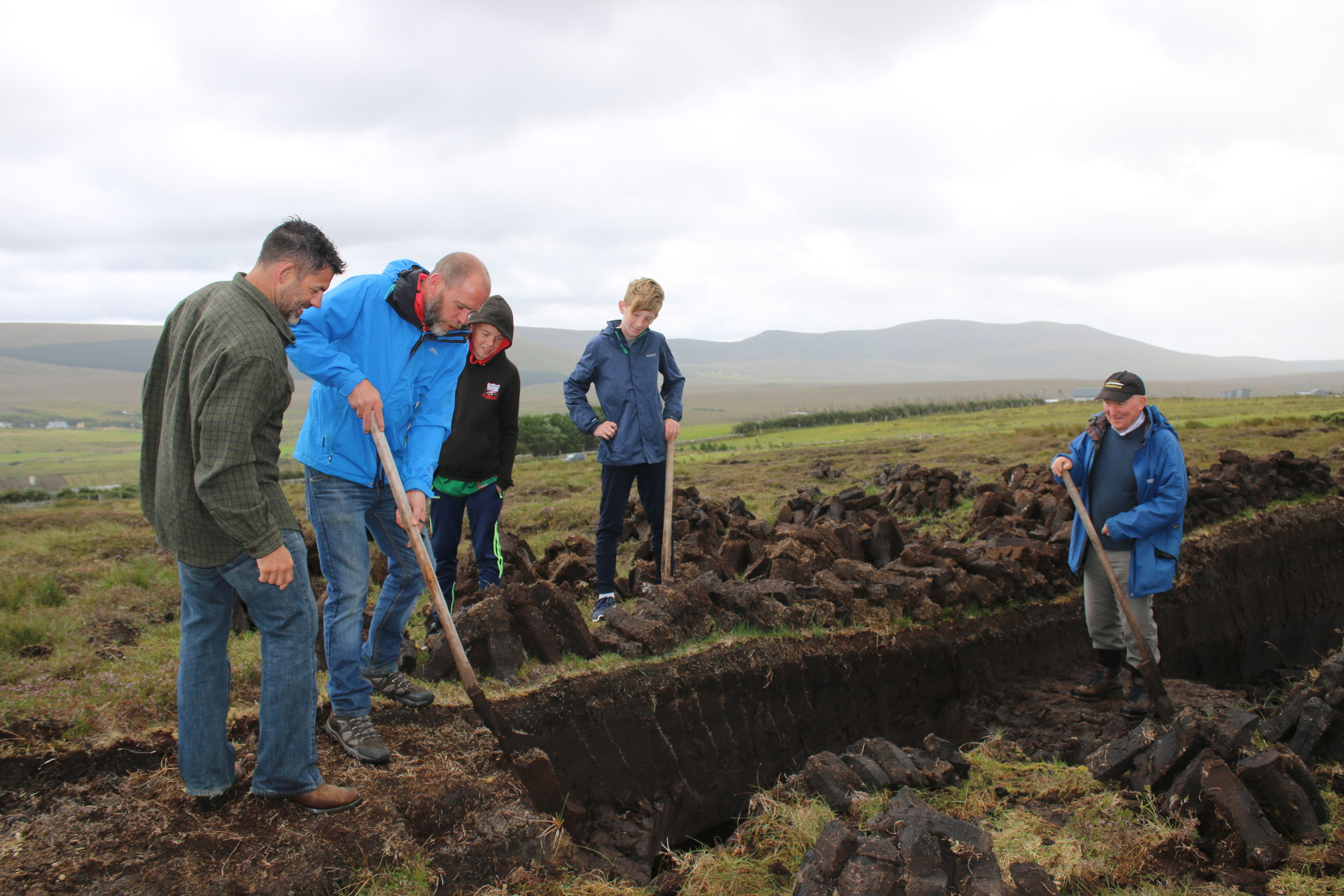 Getting a lesson in peat cutting