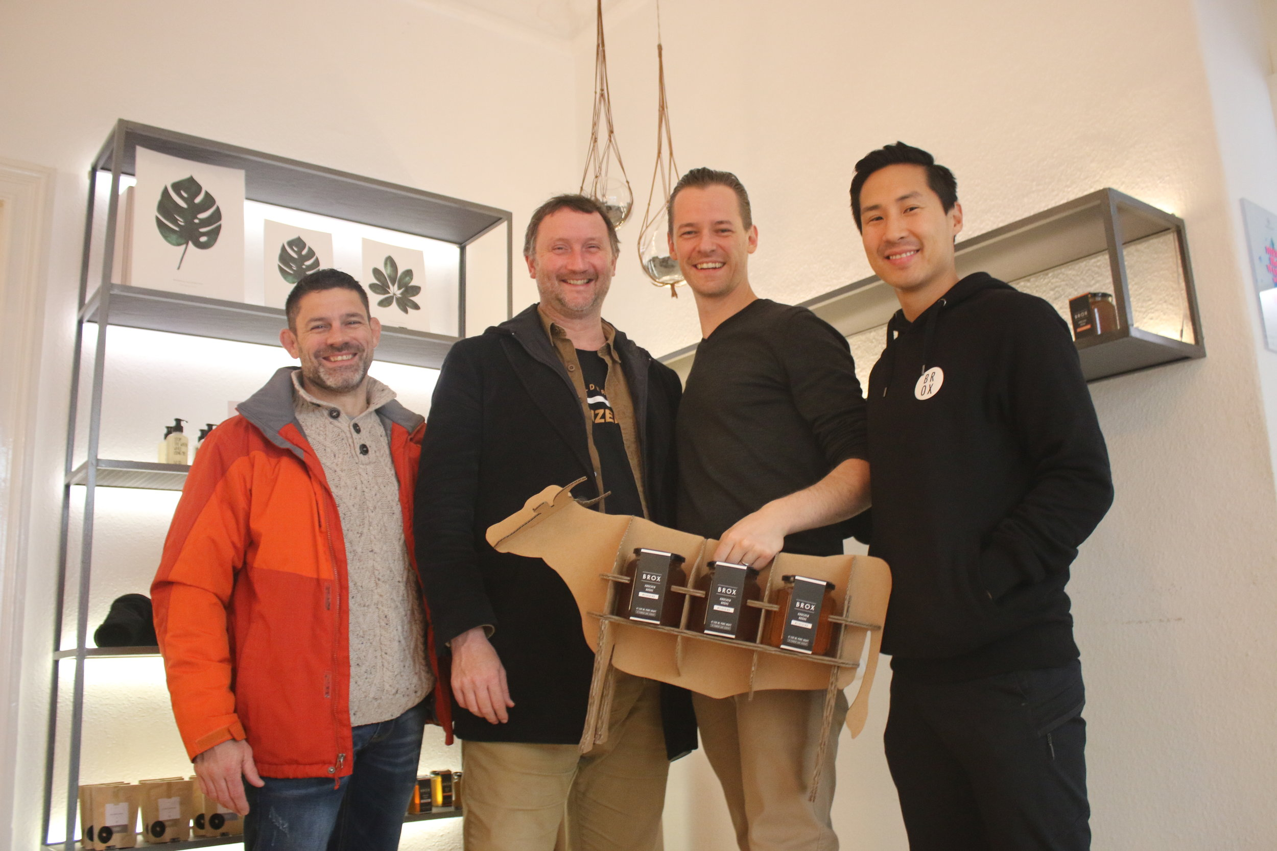 Bill, Jason, Konrad and Jin with Brox Broth in the cardboard cow carrier