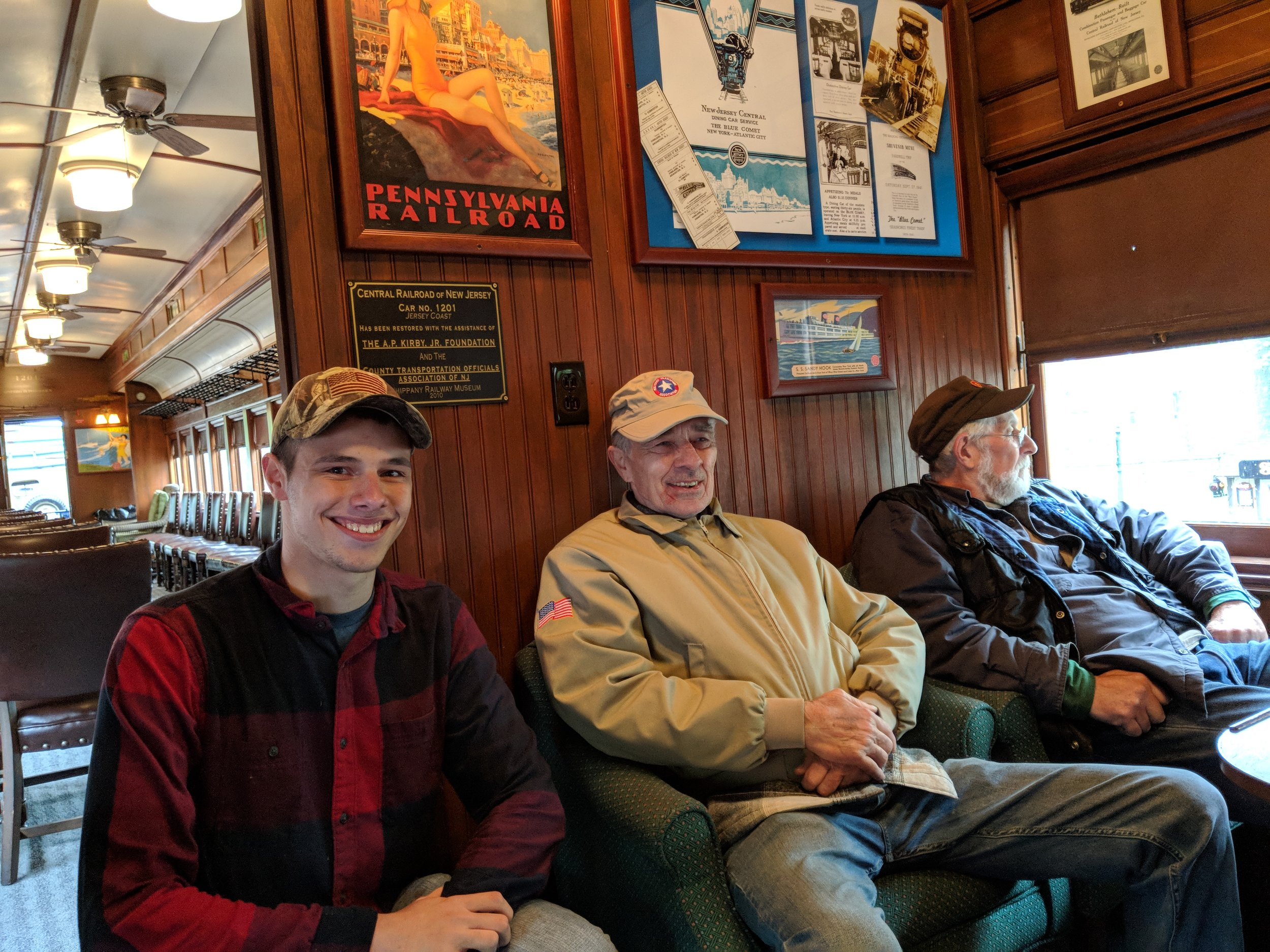 "MTA members ride in the Whippany Railway Museum's ""Jersey Coast"" club car."