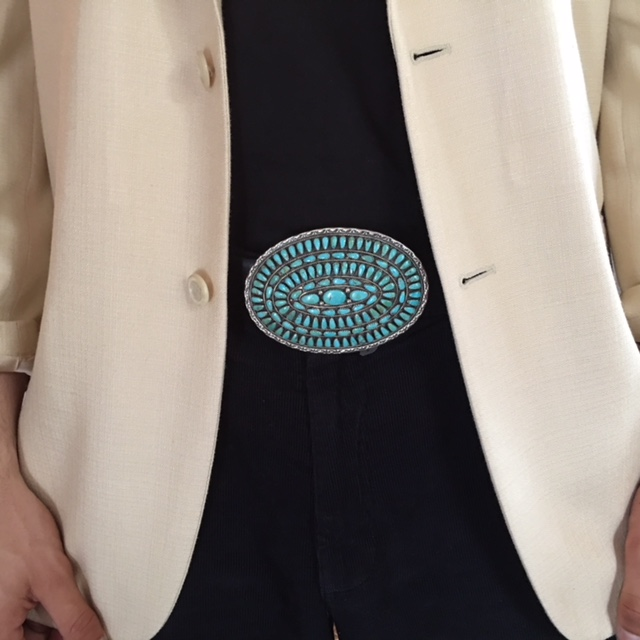 A gorgeously designed and beautifully crafted turquoise and silver belt buckle that can be worn on a belt or used as a pendant. Again, androgyny reigns. Comfortably worn by men or women as an ornament of fashion and a statement of enjoying Native American jewelry.  Price Group B.  \
