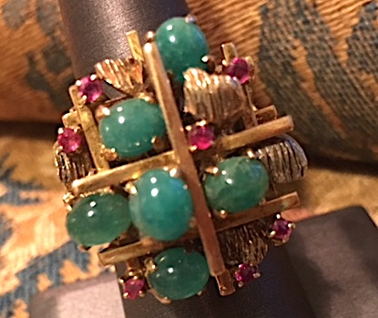 Cabochon emerald and ruby ring in a modernist setting