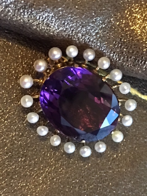 19th century oval faceted amethyst surrounded by natural pearls separated and set in gold.JPG