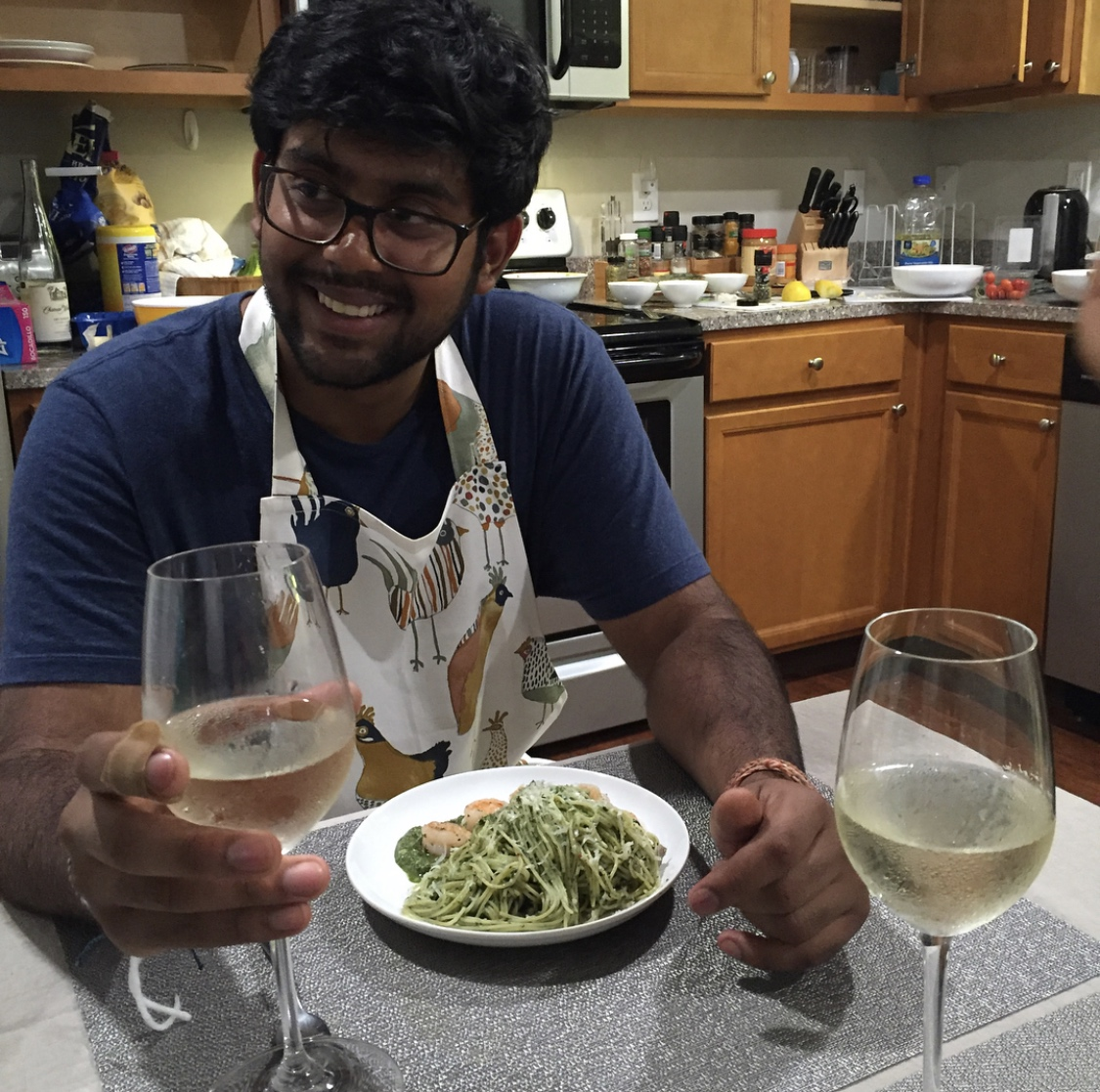 Me cooking pesto pasta with shrimp for my gang at Yen Anh's house