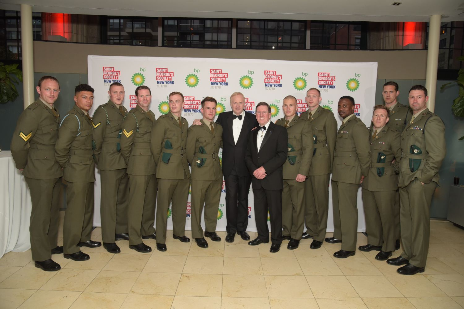 Bob Dudley and the Rt Hon Lord George Robertson pictured with the Royal Marines