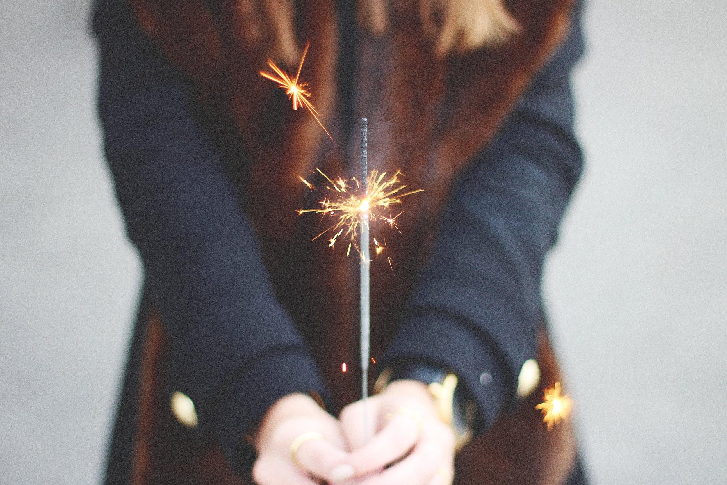 jorige-kuzmaite girl holding sparkler in front.jpg