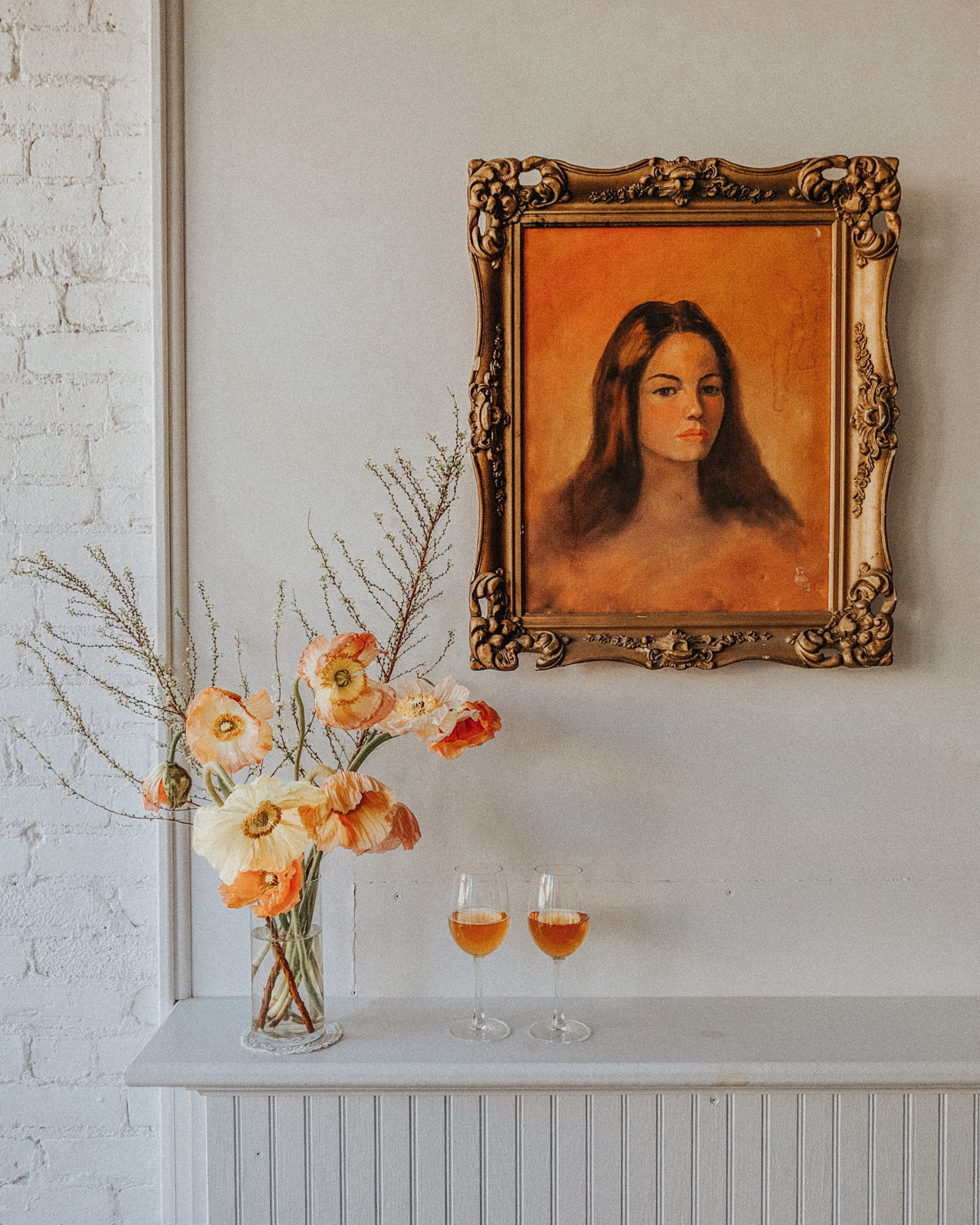 A sparkling orange for her, a still orange for him