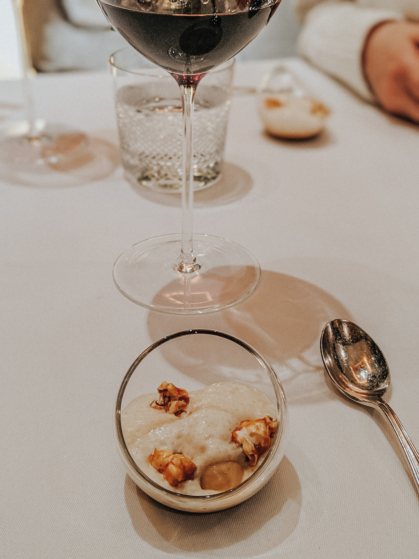 Some kind of caramel popcorn dessert with foam and ice cream — can't remember exact details.