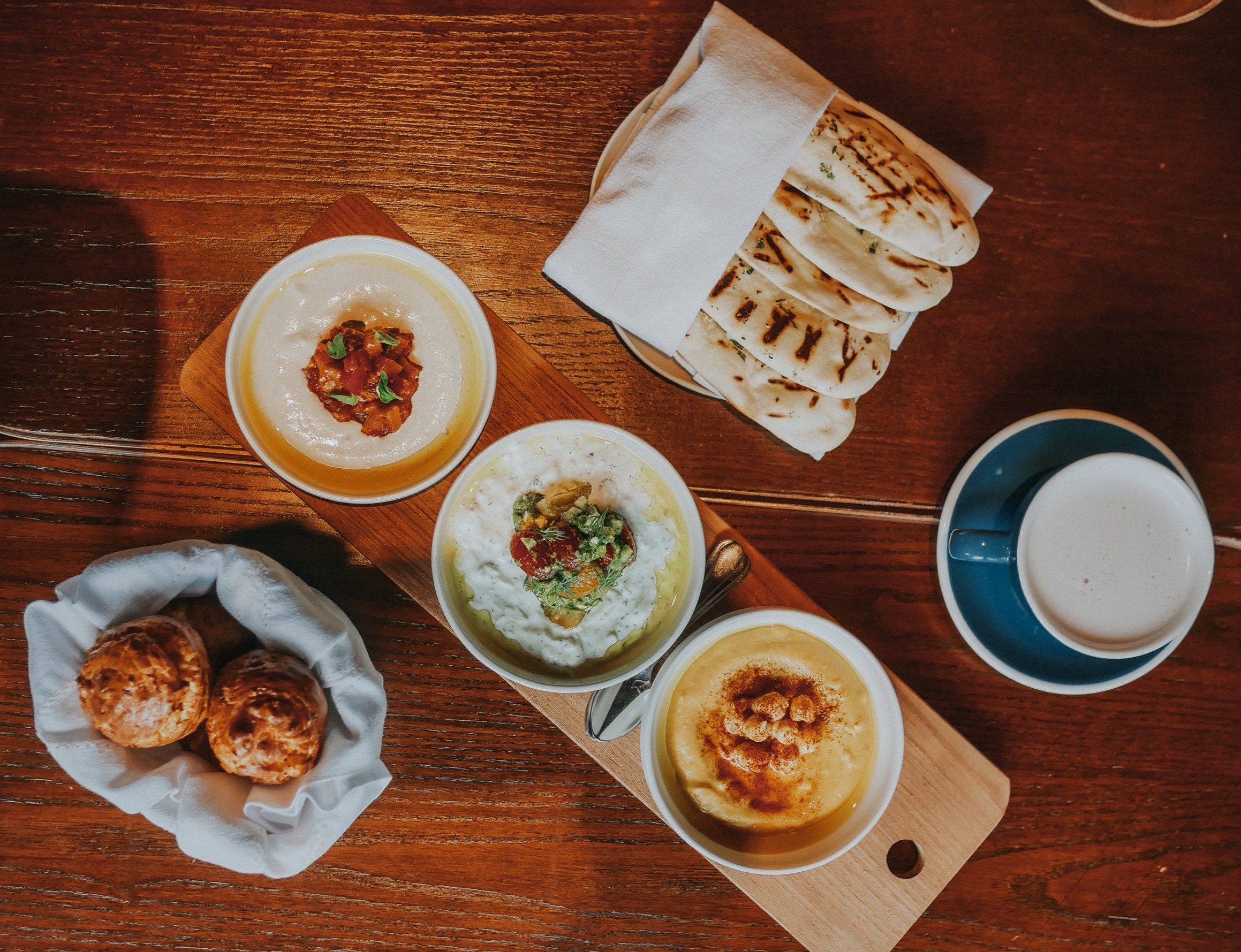 Garlic naan bread with hummus, babaganoush and tzatziki