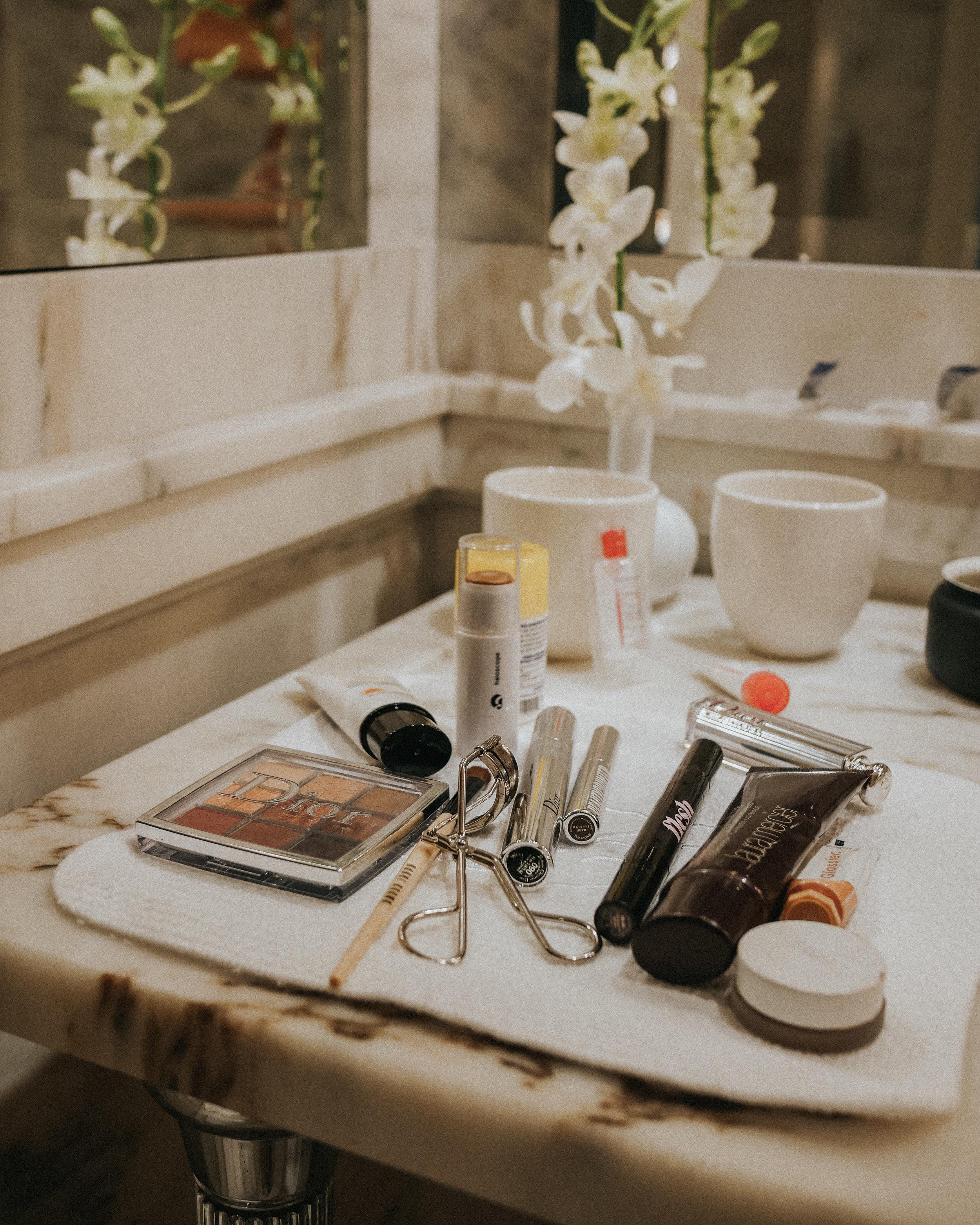 Essentials only!  Dior Backstage Eyeshadow Palette, Belif Sunscreen, Glossier Haloscope, Flesh concealer, Laura Mercier Tinted Moisturizer, RMS Beauty Bronzer, Dior Snow Lipstick, Glossier Cloud Paint in Haze.