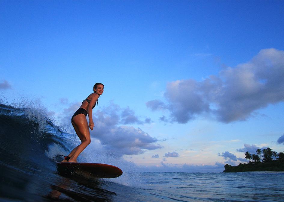 Sophie_Hellyer_Otter_wooden_surfboard_Maldives_Matt_Smith_tight_island_post.jpg