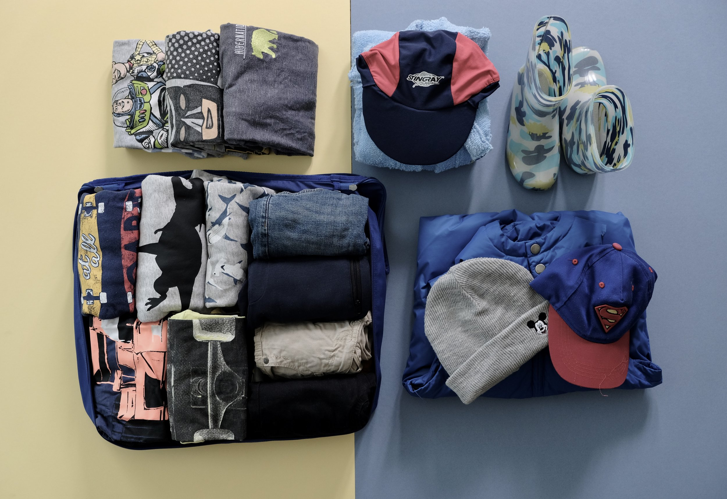 I use  packing bags  to organise and contain the clothing.