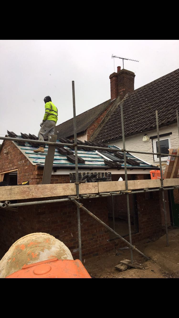 Before:  Extension roof ready for retiling