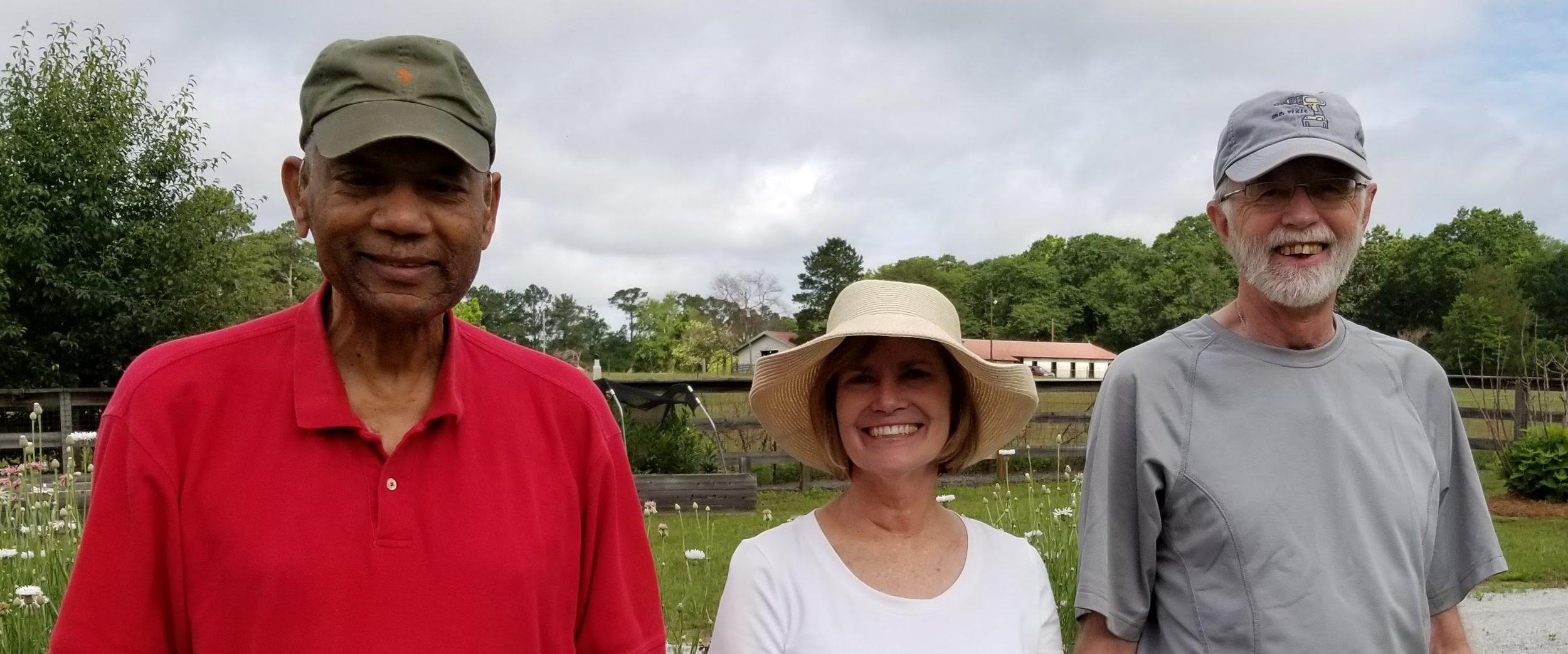 Volunteers Ted Williams, Kathy Olson and owner Rufus Bradley