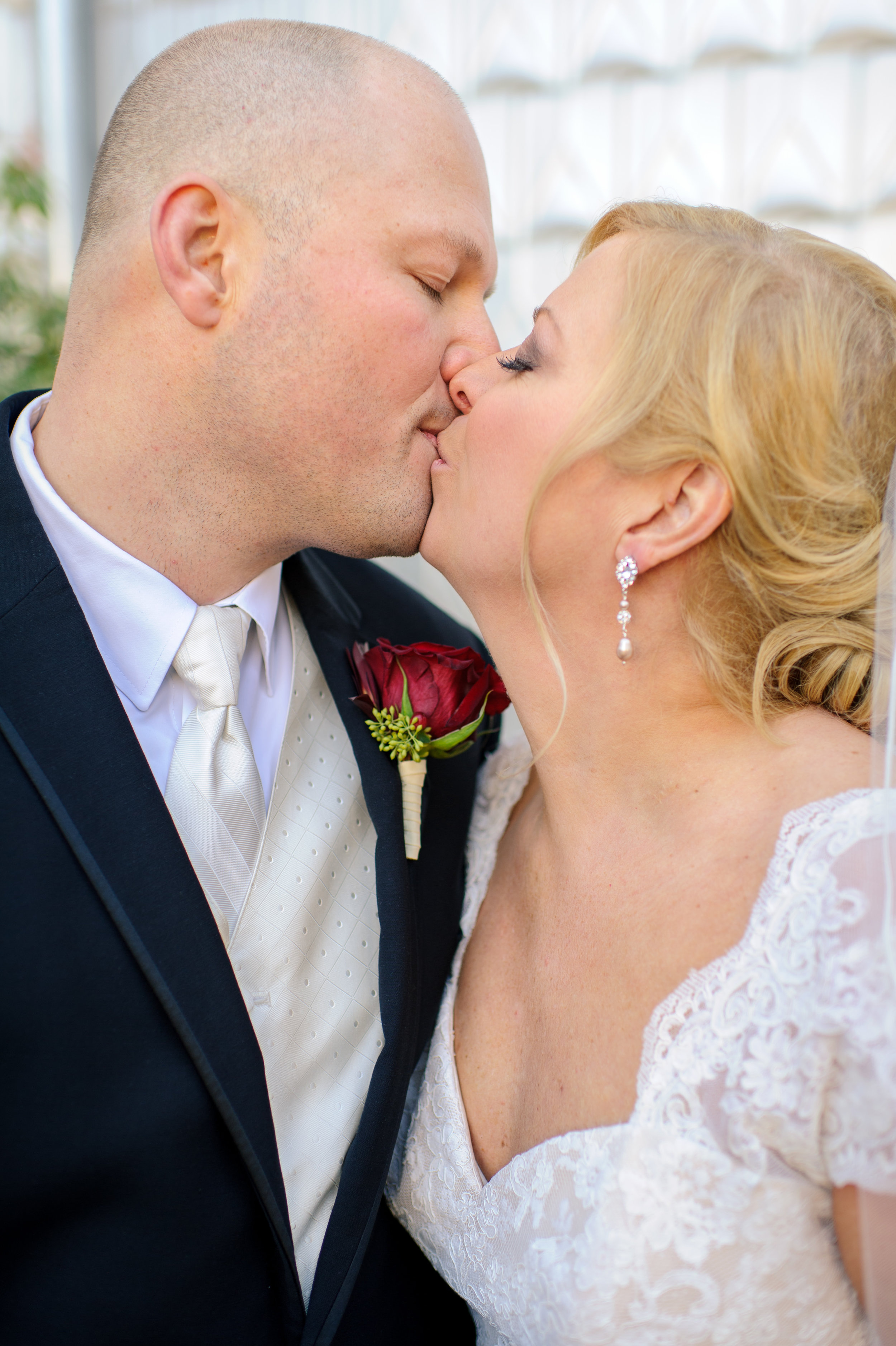 Christine and Karl Romantic Outdoors Bridal Bride and Groom Portrait Kiss at the Edgewater Hotel Waterfront in Seattle Washington