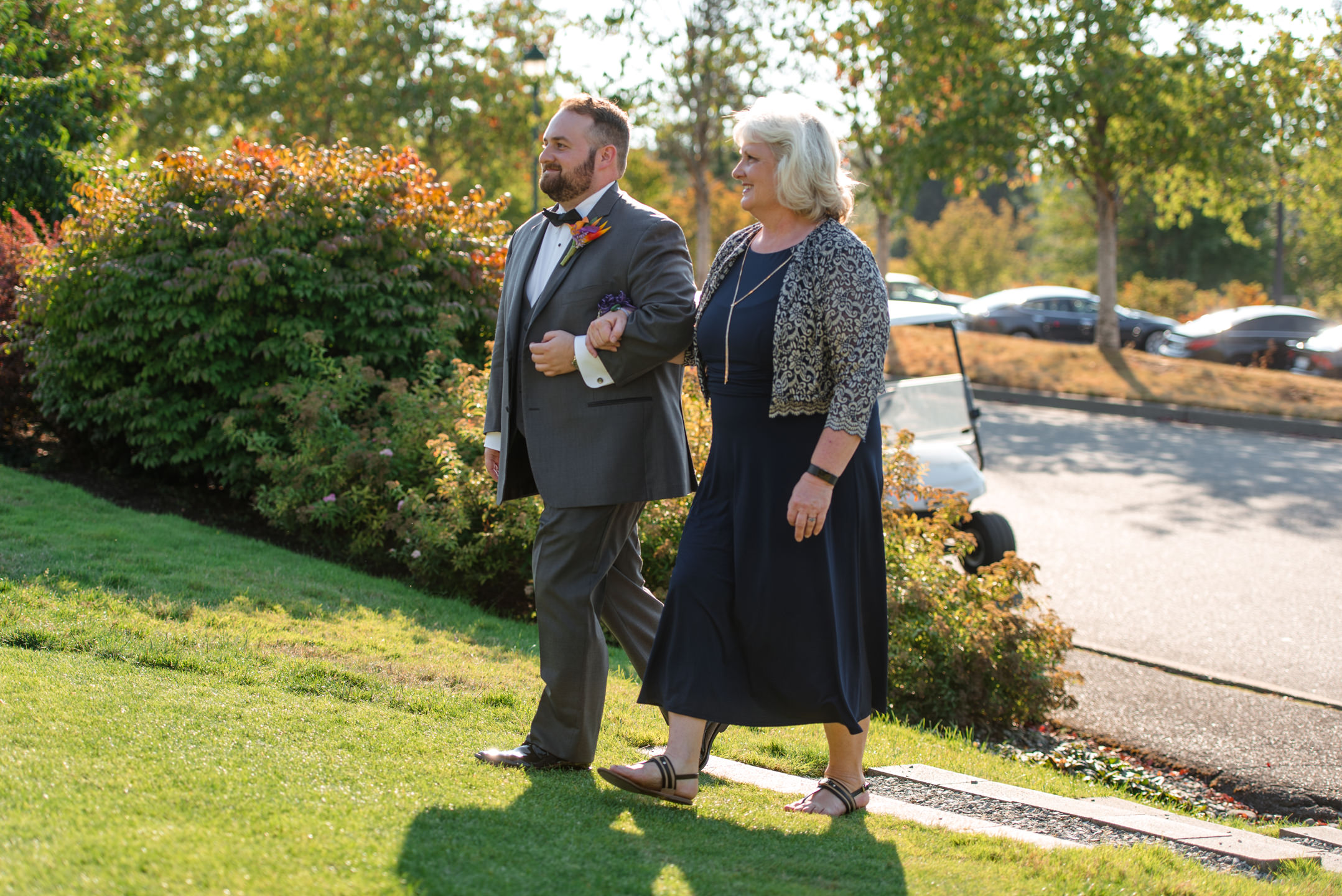 Groom and Mother Walk Down Aisle at Wedding Ceremony