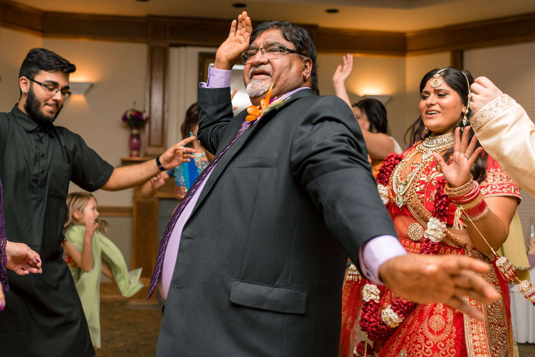 Indian Father Dances during Happy Wedding Reception