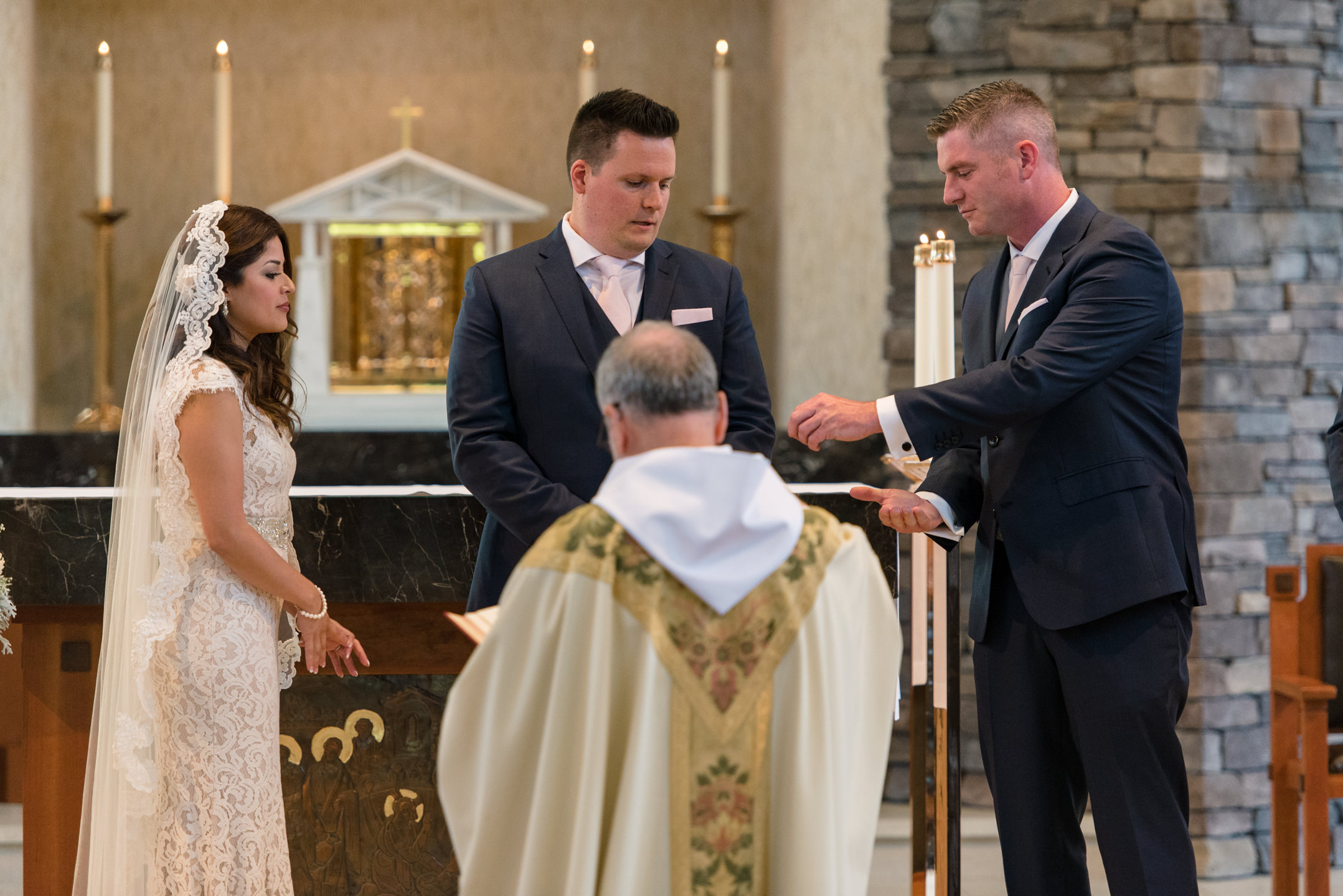 Best Man Gives Rings to Groom during Wedding Ceremony at Saint Theresa of Calcutta