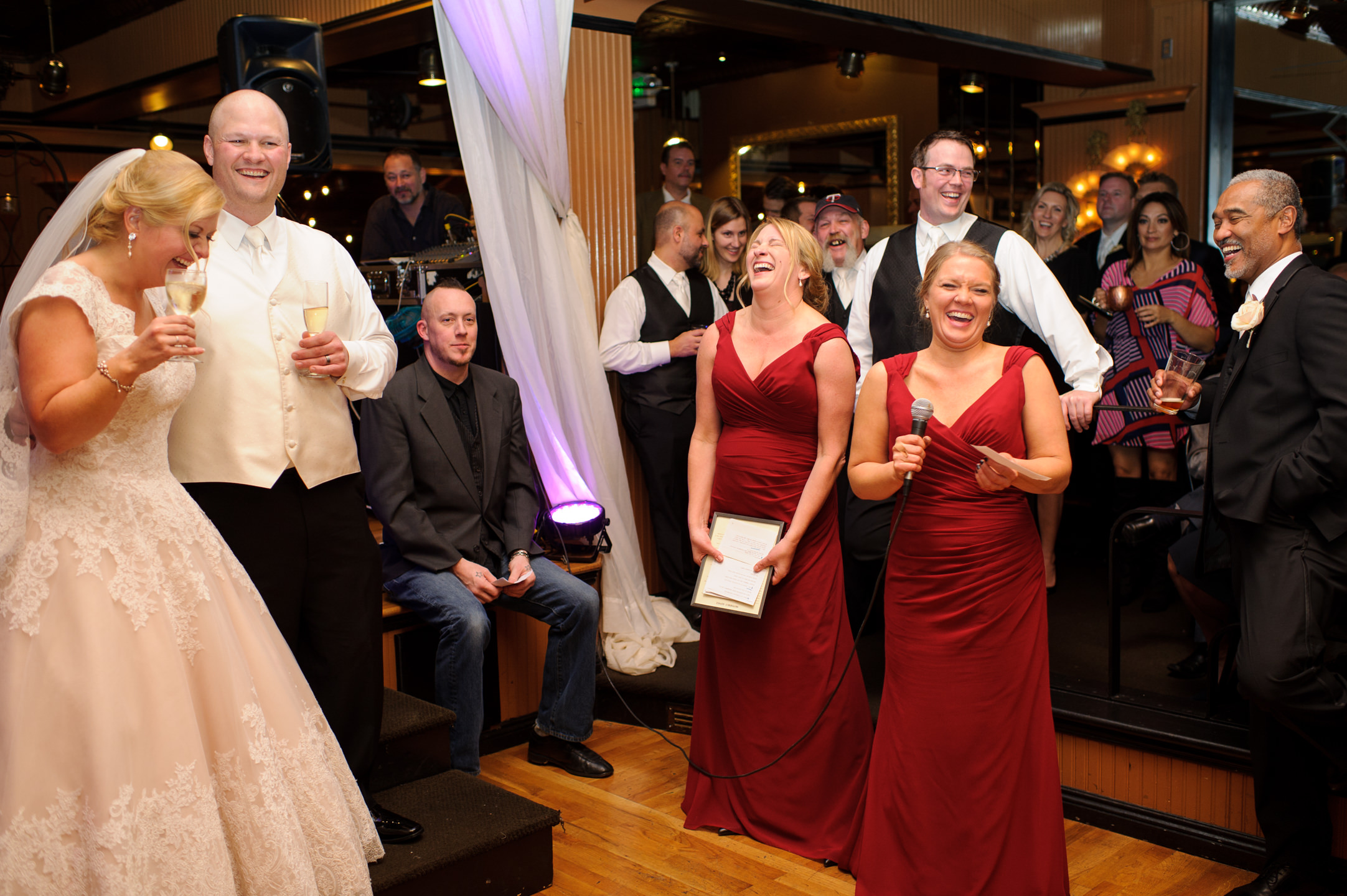 Bride and Groom Laugh During Bridesmaids Wedding Toast at Lake U