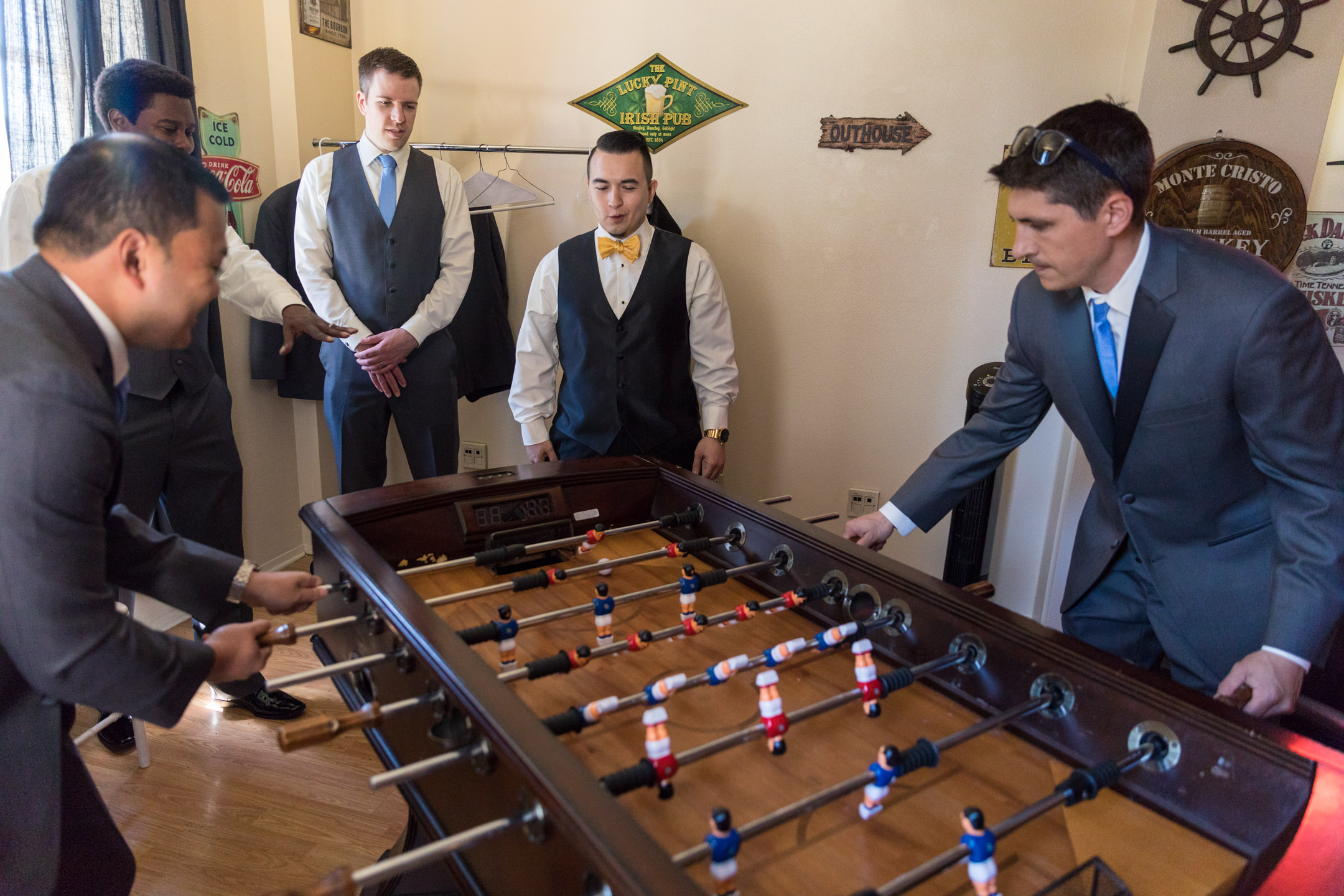 Groom and Groomsmen Playing Foosball