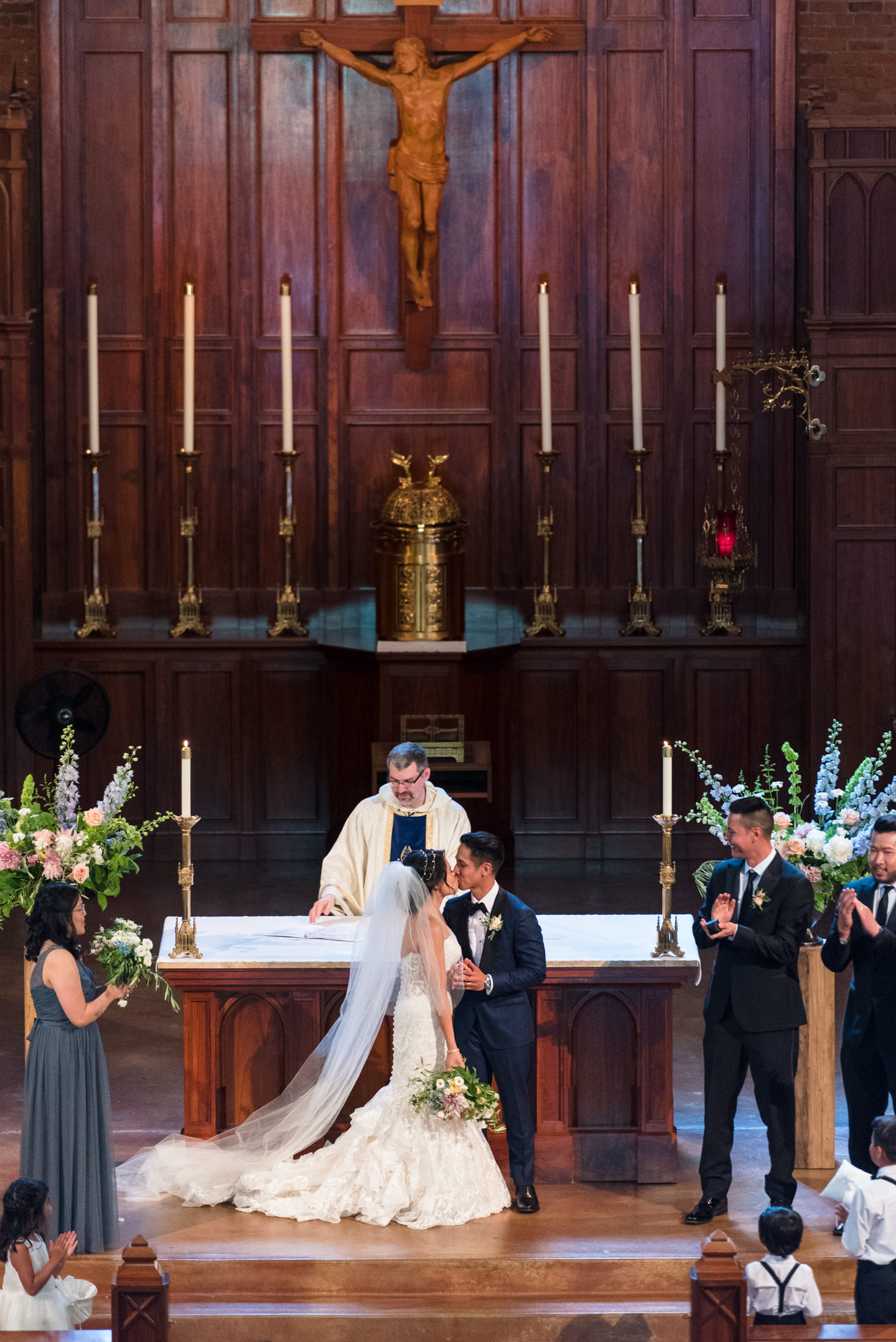 Asian Bride and Groom Kiss during Wedding Ceremony