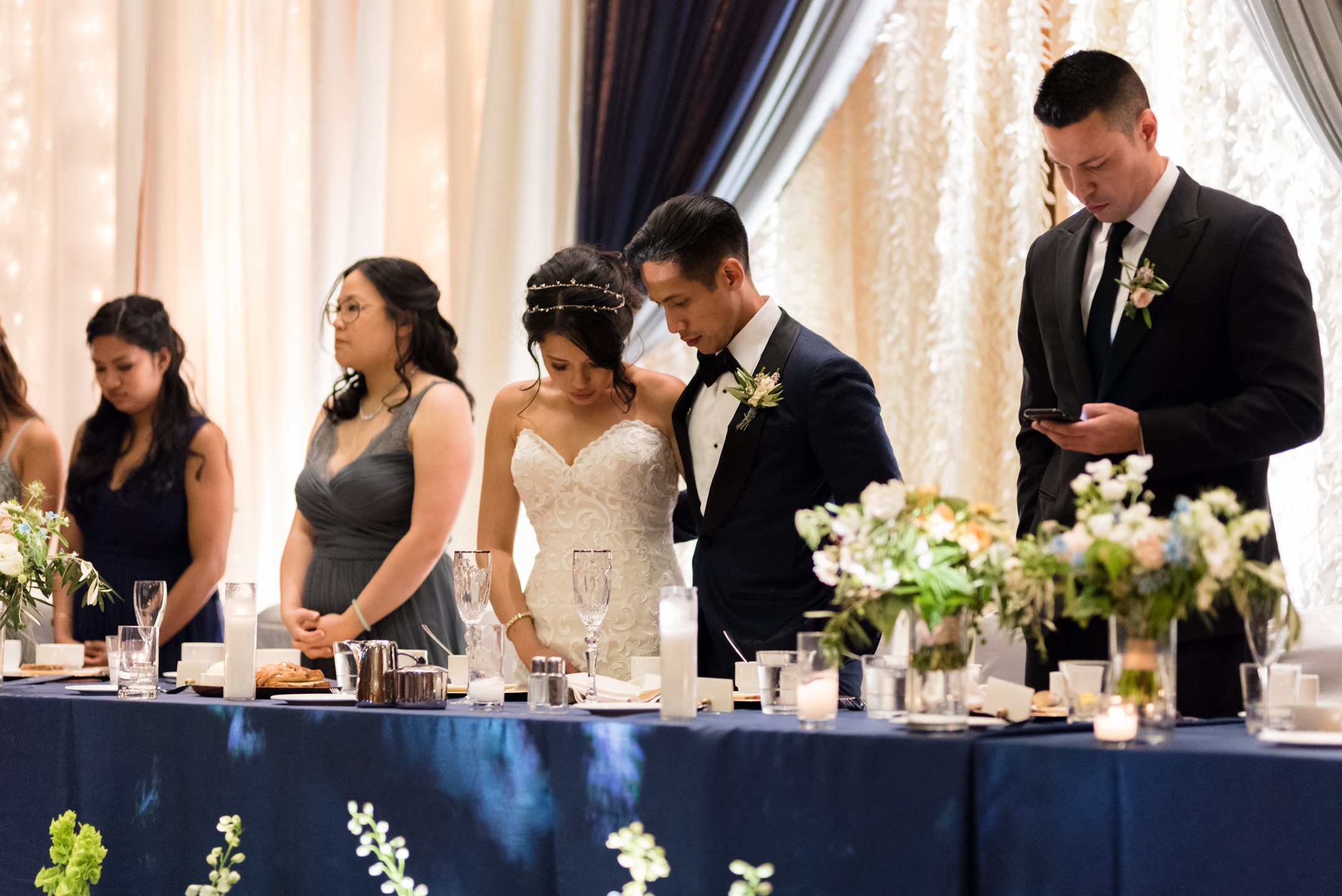 Asian Bride and Groom Pray before Dinner at Olive 8