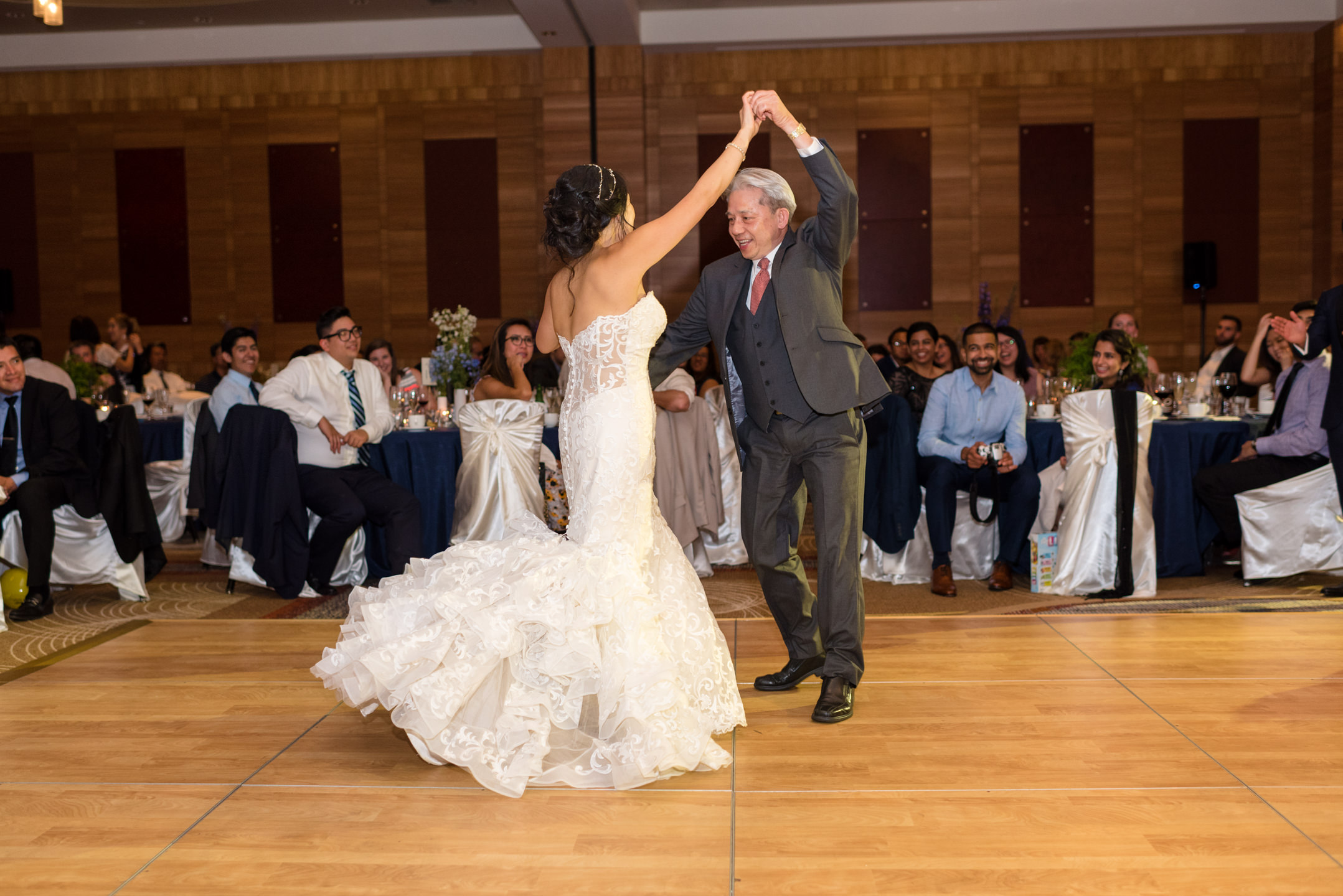 Asian Bride and Father Dance during Wedding Reception