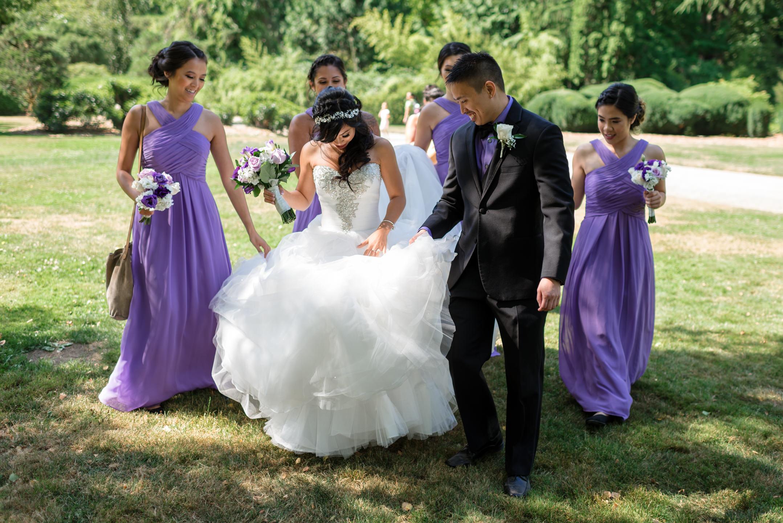 Asian Groom and Bridesmaids Help Bride with Dress at Kubota Gard