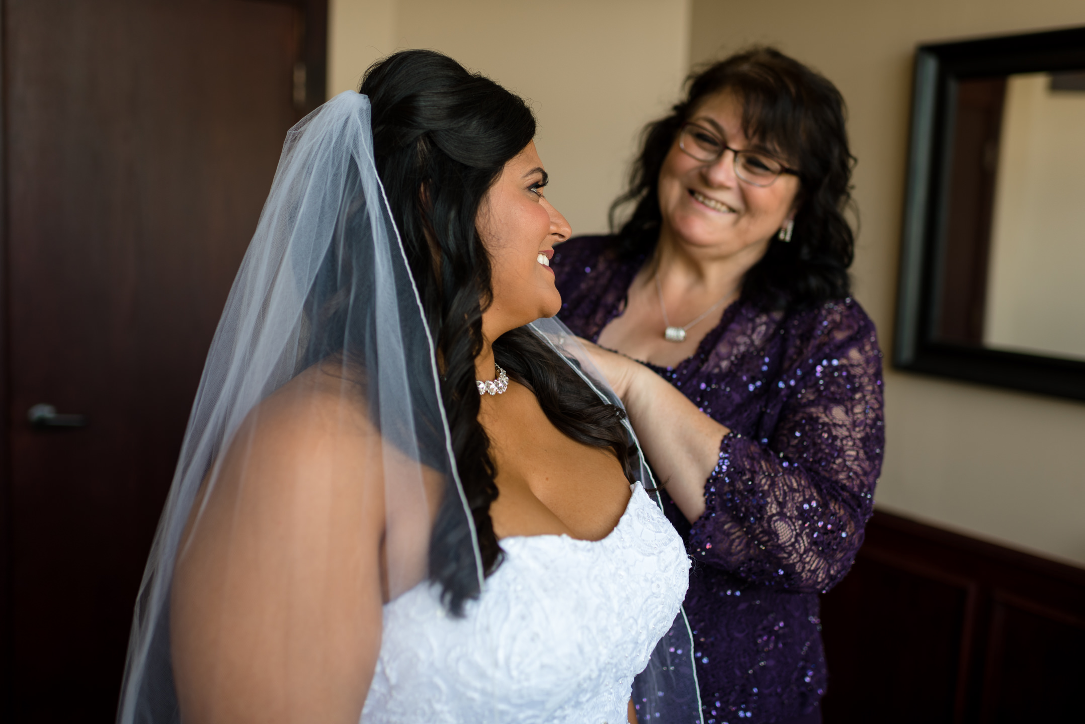 Happy Mother and Indian Bride Smile while Getting Ready